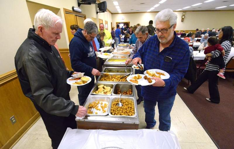 Diners filled their plates Friday night in Marion at the Knights of Columbus' first of their weekly Lenten Fish Frys.