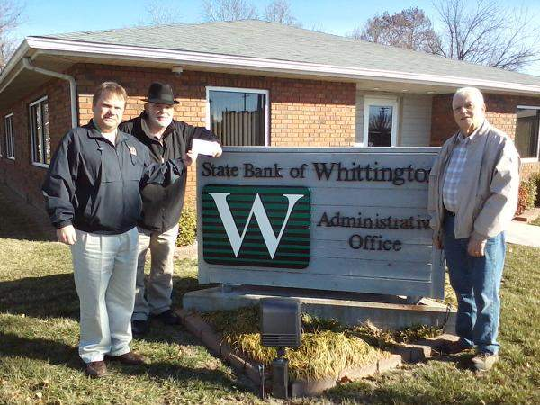 Officials with the State Bank of Whittington have contributed $500 to help the local Habitat for Humanity organization.