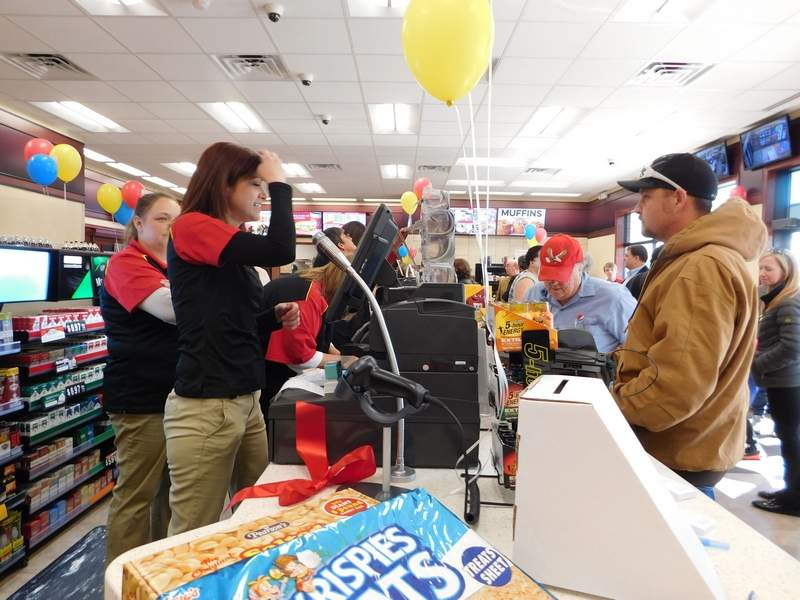 Customers lined up to take advantage of specials and freebies as the new Casey's General Store opened in West City Friday. Casey's District Manger Mary Ham said the new facility sports several differences including a different layout and larger coolers and donut cases. 'I'm going to get here as often as I can,' Ham said with a smile.
