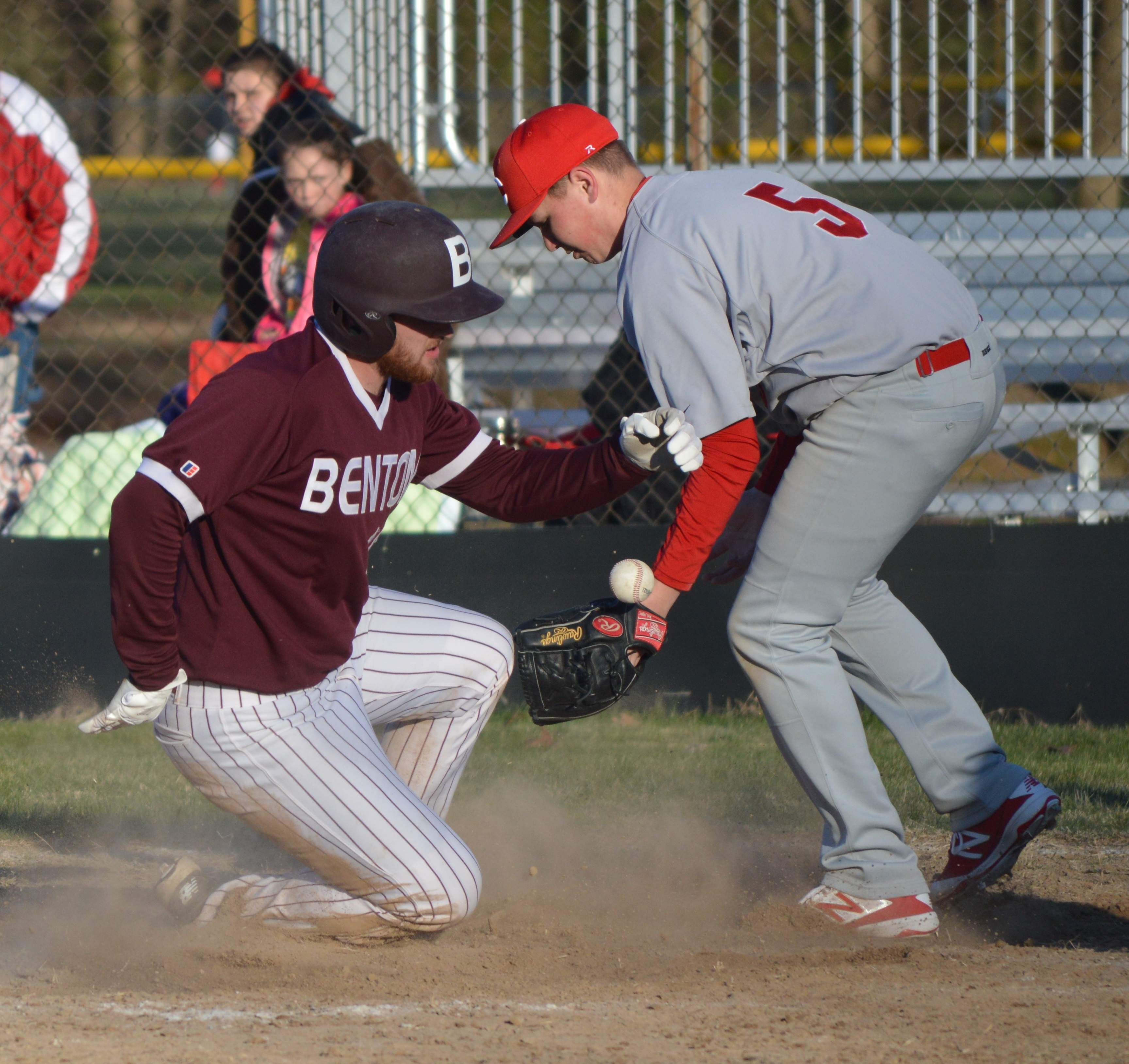 Senior Bryden Picklesimer (left) slides into home plate Wednesday during the Rangers' season opening 17-7 victory over the Centralia Orphans.