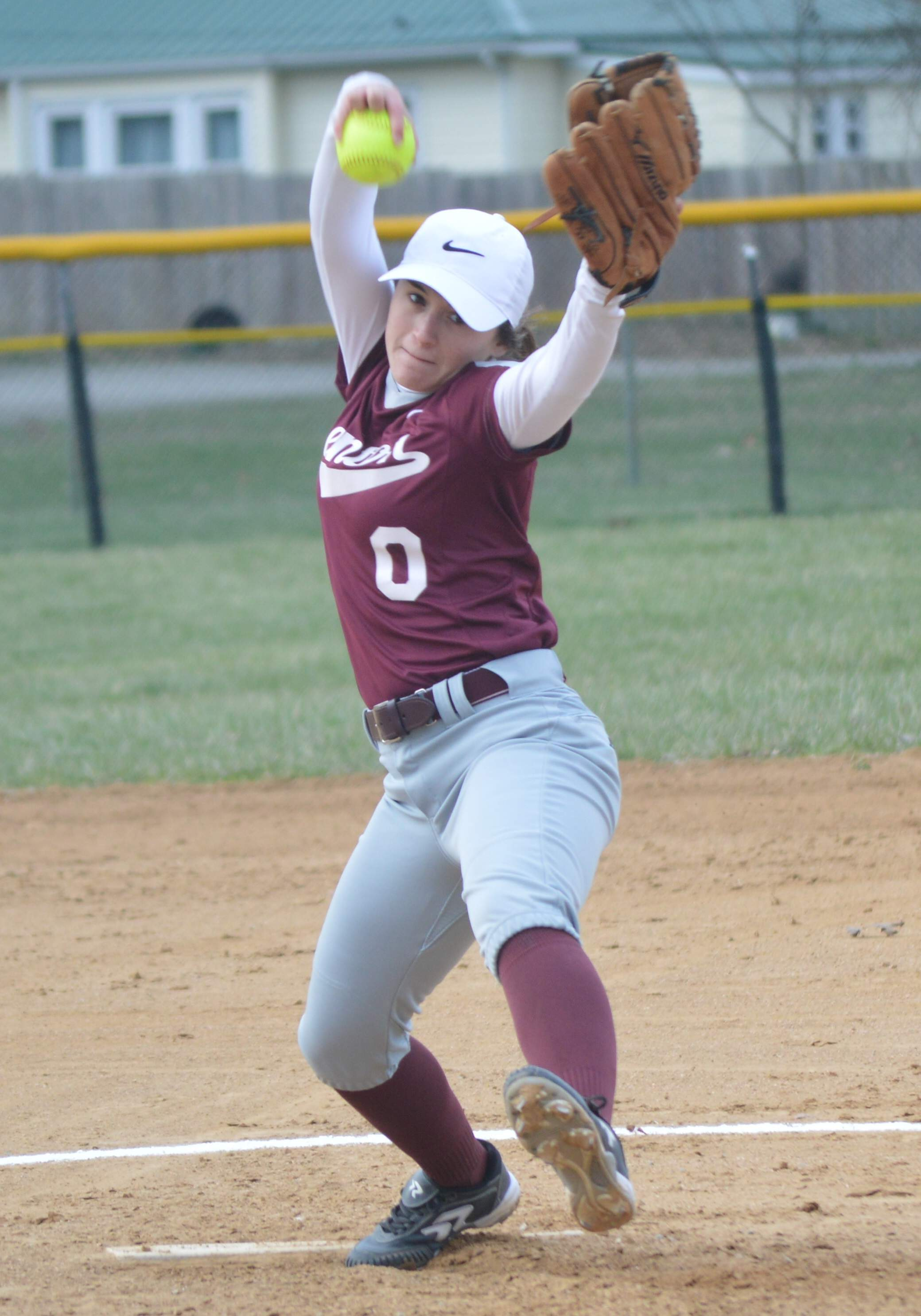 Starting pitcher Eb Casey winds up to deliver a pitch Thursday during the Rangerettes' season opening game against the Salem Wildcats.