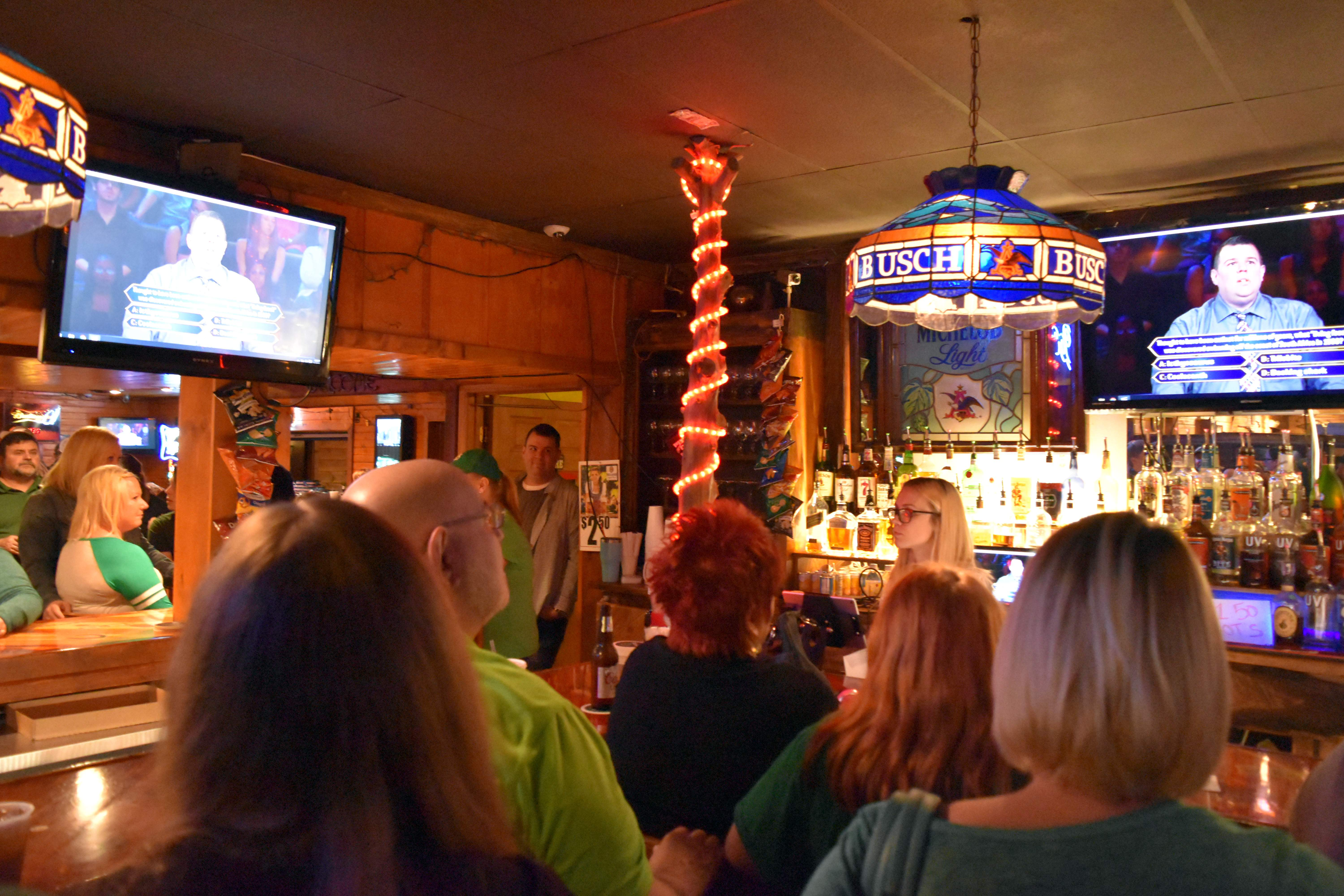 "Patrons at Pistol City Restaurant and Saloon in Coulterville watch the establishment's general manager, Kyle Hinnerichs, compete on ""Who Wants to Be a Millionaire?"" last Friday. Pistol City hosted a viewing party for Hinnerichs' appearance, which was taped in August 2016."