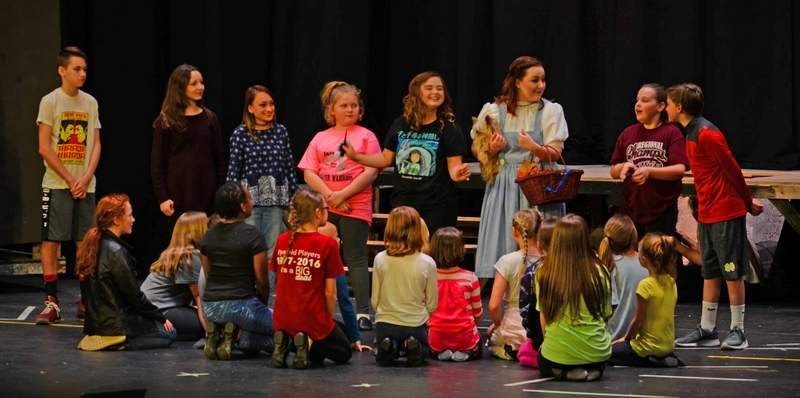 Dorothy Gale, played by theater veteran Olivia Bailey of Mt. Vernon, speaks to the 'munchkins' during a rehearsal for Rend Lake College's production of 'The Wizard of Oz.' Tickets are now on sale for the show, which opens at 7 p.m. tonight, April 6.