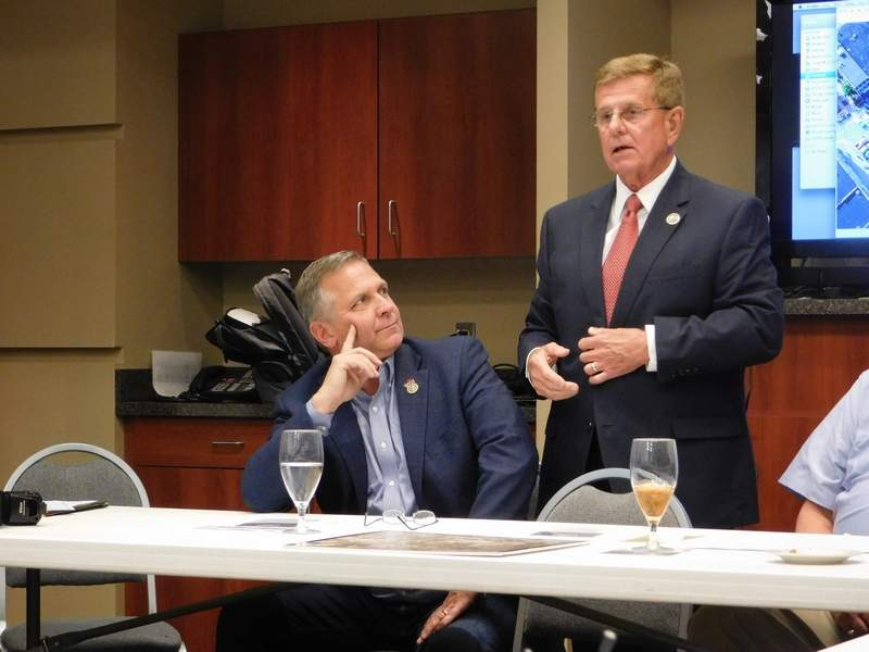 Benton Mayor Fred Kondritz updated Congressman Mike Bost on the changes happening in Benton at yesterday's economic summit.  Along with a new logo, Benton has also 'bought and paid for' a new police station and city hall building.  Kondritz told Bost the new city hall was a huge improvement in space and security. 'al-Quaida could not drop this building,' he said.