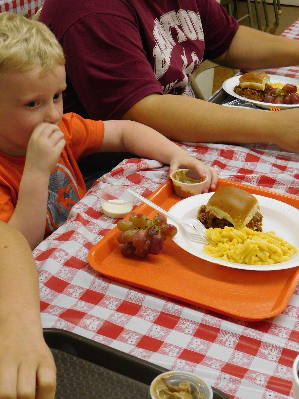 Three-year-old Gage Goeke enjoyed the carrots and peanut butter that were part of his Monday lunch.  'Everything tastes wonderful,' said Gage's mother, Heather Dale. 'It was very nice of them to do this.'
