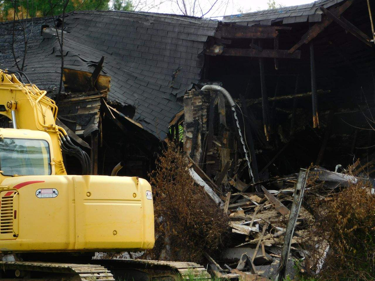 After pumping water from the basement during the morning, demolition was in full swing by early afternoon on Wednesday. Garavalia said the work was bid on an emergency basis, citing safety concerns with the structure. A & P Excavation is completing the work.