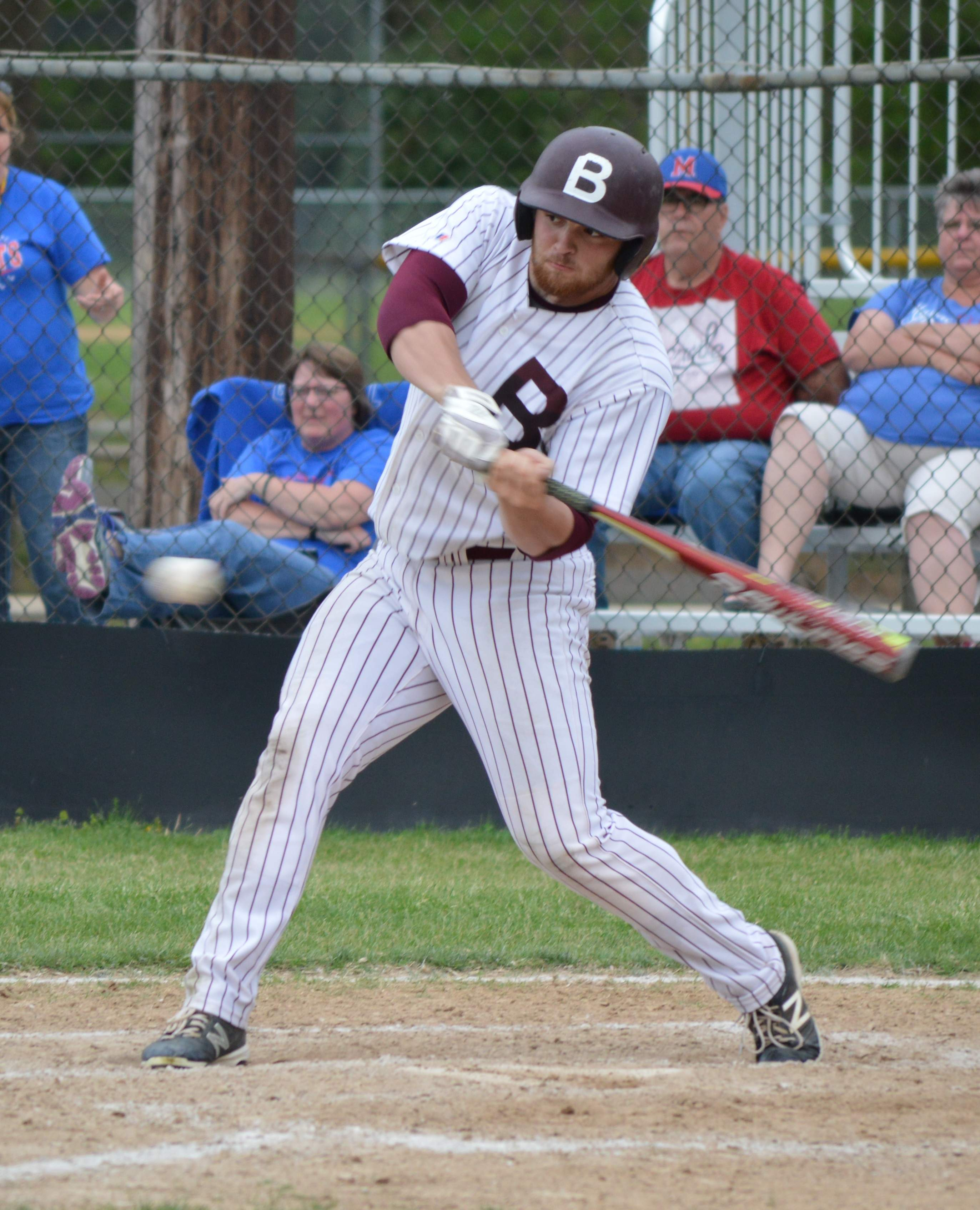 Bryden Picklesimer takes a swing at the ball during the Rangers' game against Massac County.