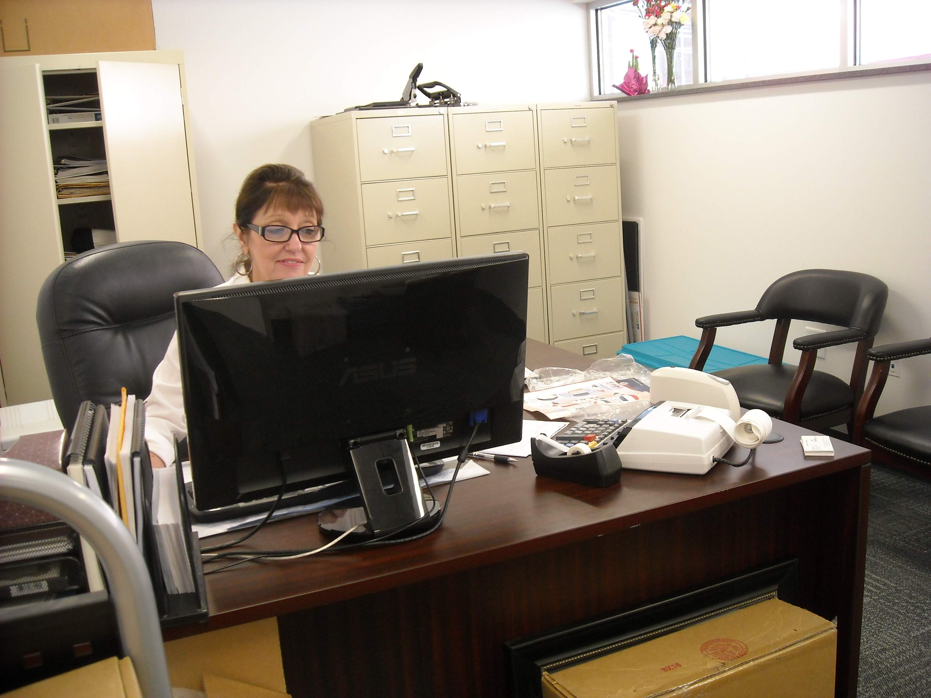 Franklin County Administrative Assistant Gayla Sink works in her new office space at the Campbell Building. Several officeholders have now moved into the renovated facility. River City Construction was awarded the $550,000 contract.
