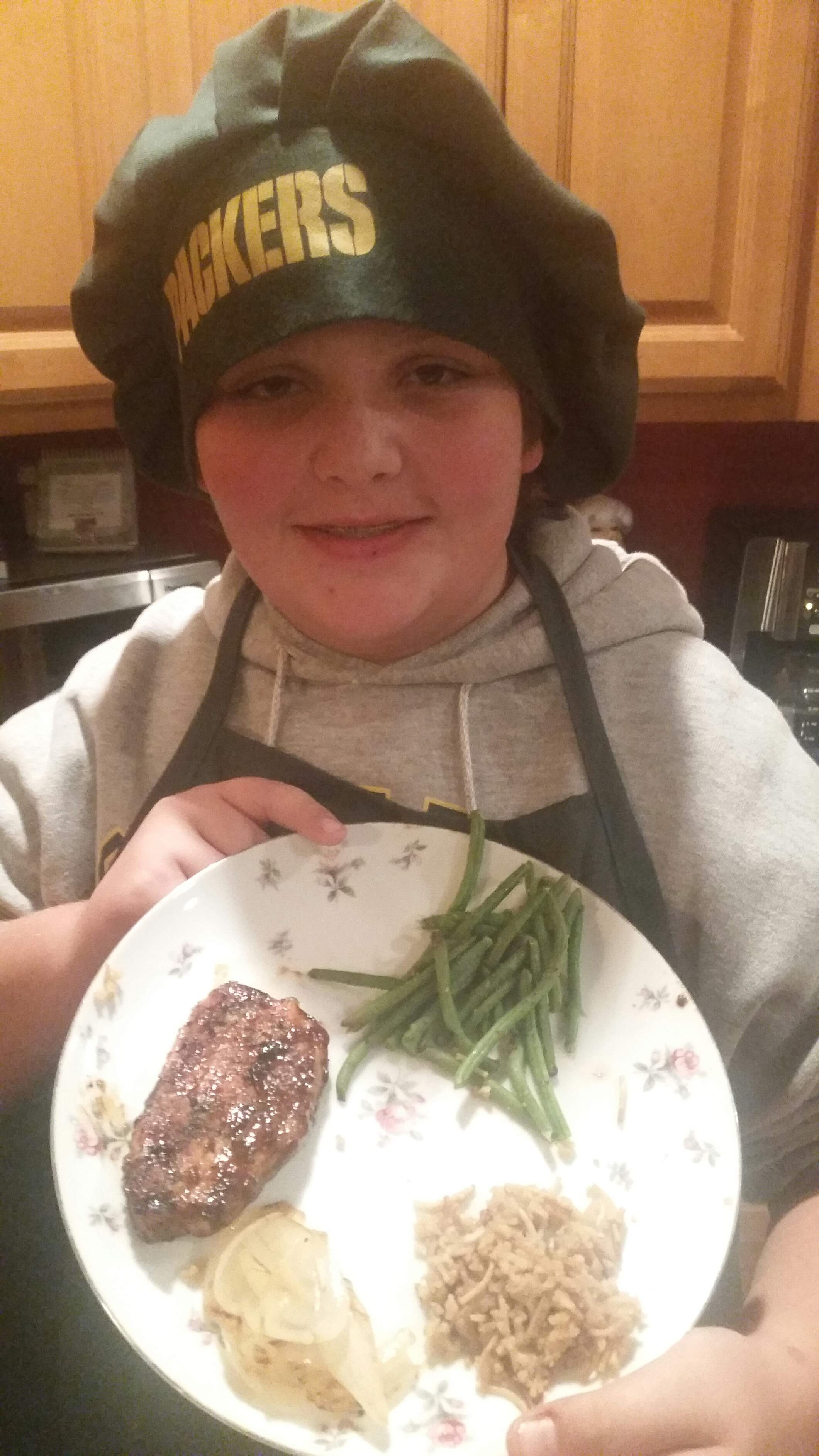 Josh Loyd, 12, of Marion, shows off one of his prepared meals. Loyd will appear June 12th on the Food Network's show, 'Kids BBQ Championship' at 7 p.m.