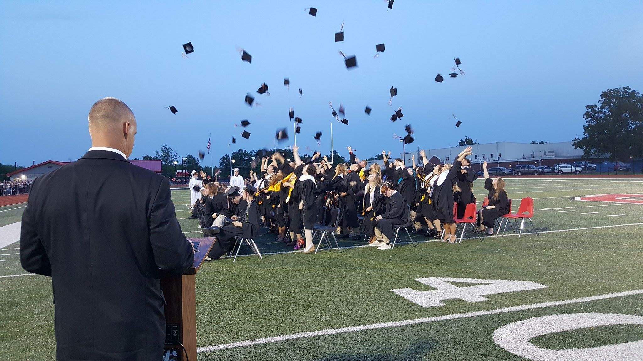 """The Johnston City High School Class of 2017 celebrate the """"official"""" end of their high school career with the traditional throwing of the hats, as principal Joey Ohnesorge pronounces them """"graduated.""""  Ohnesorge will leave the school with the class to fill the principal position at Marion High School."""