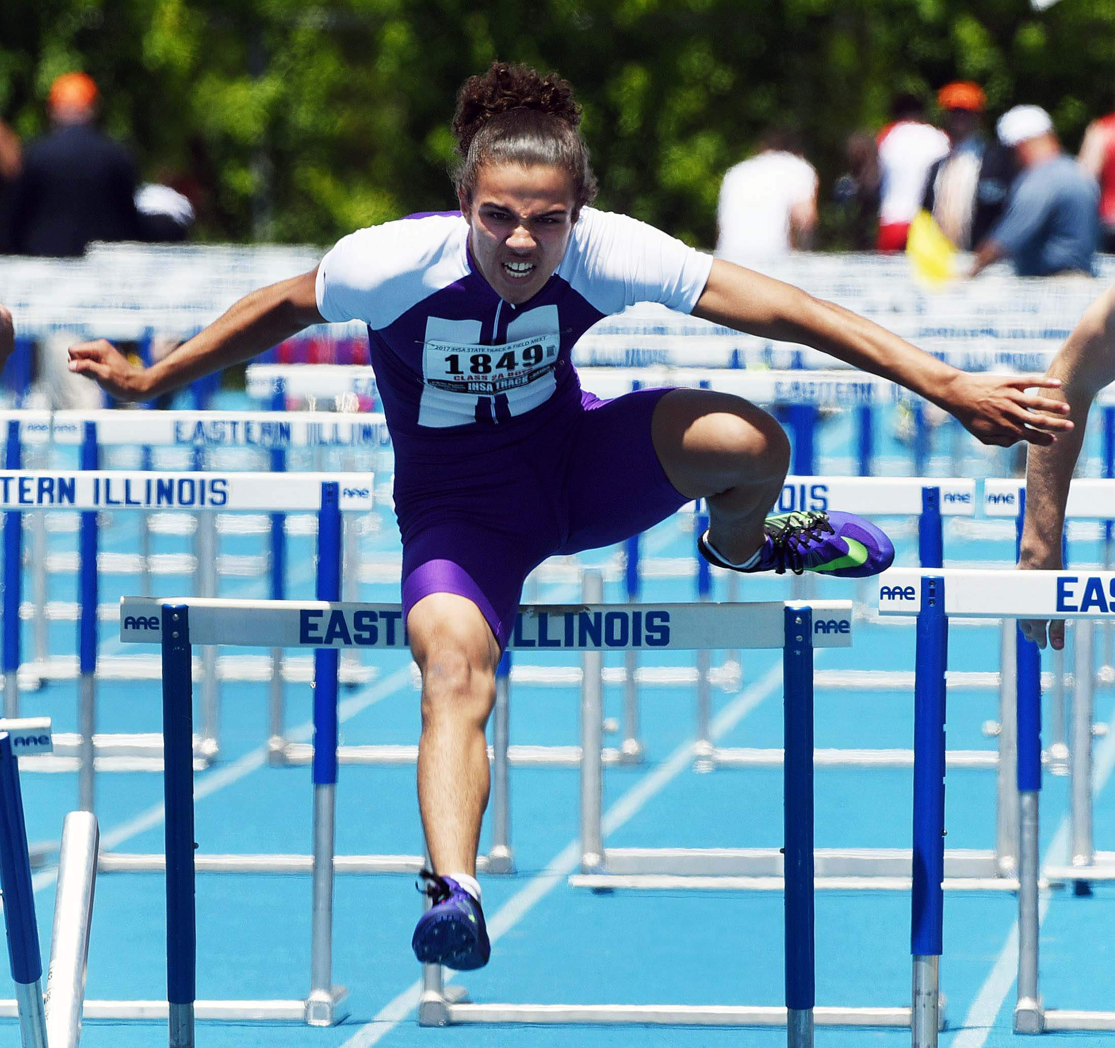 Harrisburg's Niko Neal clears the final hurdle during the class 2A 110-meter high hurdles during the boys state track and field finals at Eastern Illinois University in Charleston Saturday.