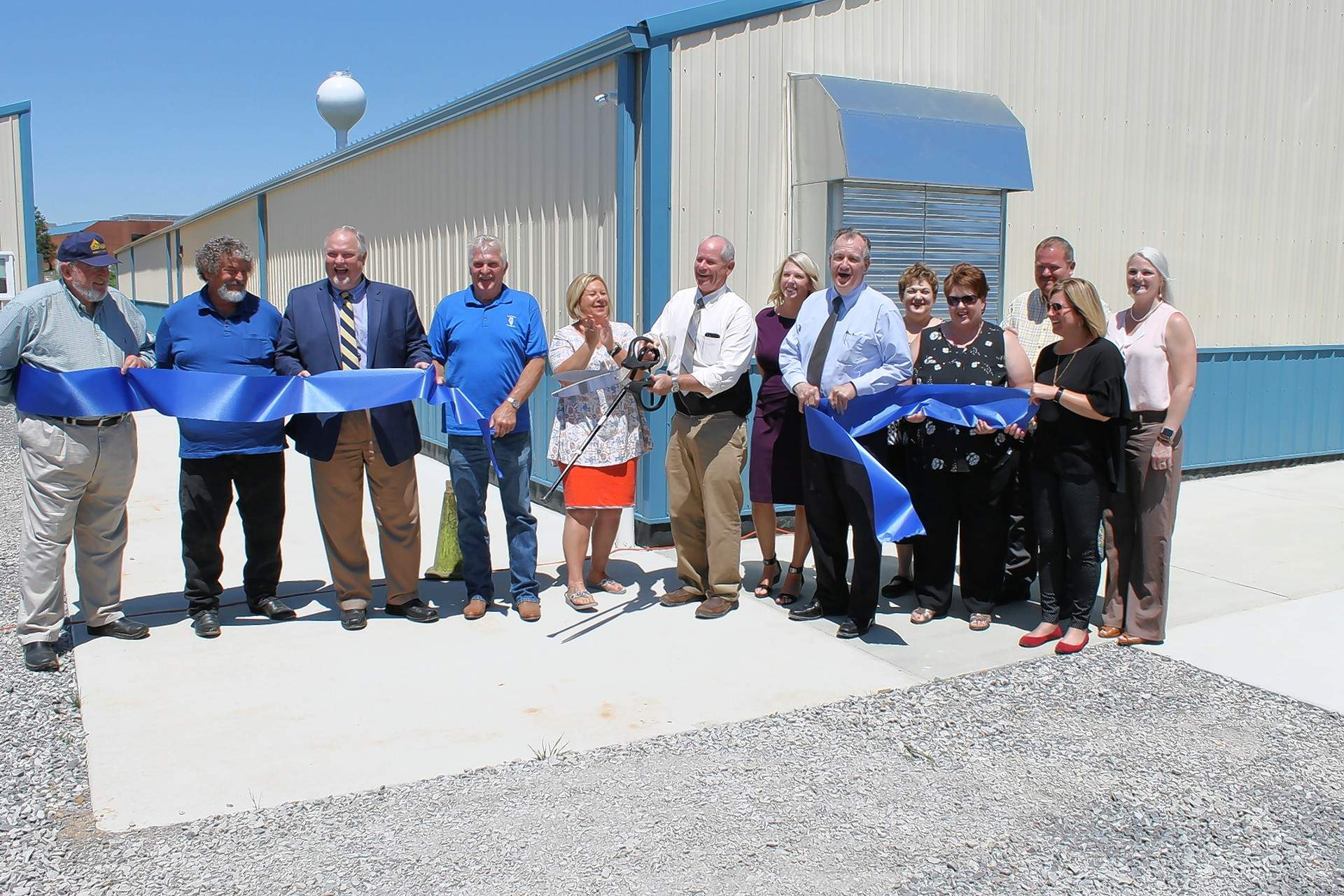 SIC and Illinois Eastern Community Colleges has a grand opening ribbon cutting ceremony for the Simulated Mine Training Facility, which will be used in the Mine Rescue & Skills Competition June 13 and 14. From left, Jim Ellis, SIC Board Secretary; Pat York, SIC board chairman; SIC President Jonah Rice; Bill Patterson, Illinois Office of Mines and Minerals inspector at large; Stacy Wasson, Saline County chamber president; Mike Thomas, IECC dean of Workforce Education; Brandi Bradley, aide to U.S. Sen. Dick Durbin; Terry Bruce, CEO of Illinois Eastern Community Colleges; Lori Cox, SIC associate dean of Workforce Education; Karen Weiss, SIC vice president for Academic Affairs; Scott Stout, Saline County chamber treasurer; Olivia Bradley, chamber past president and Jessica Stephens, chamber secretary.
