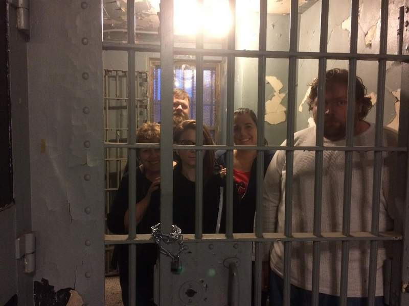 """From left, Holly Kee, Jeremy Ellis, Haley Elam, Amanda Jarzynski and William McPherson teamed up last month to face the Escape Challenge at the Franklin County Historic Jail Museum in Benton. The jail that trapped Charlie Birger for a year also held the  """"Newshounds"""" beyond the 60-minute time limit."""