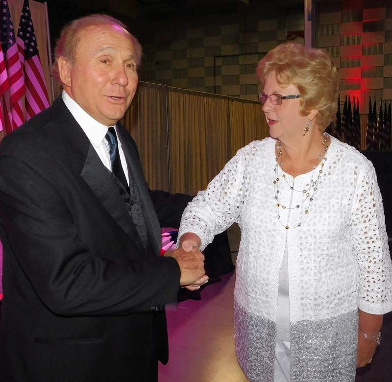 Rebecca Borgsmiller, of the John A. Logan College board, spends a few moments chatting with Michael Reagan at the Ronald Reagan Tribute Gala at the Marion Pavilion Friday evening.