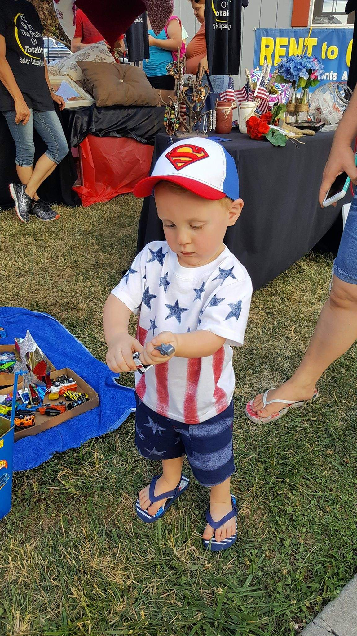 Ayden Arview, 2, of West Frankfort found a toy to his liking at a vendor booth as his parents, Mary and Loren, browsed the various booths prior to the fireworks show. There were several unique vendors including disc golf, a wood artisan and a booth featuring different 'rocket' launchers.