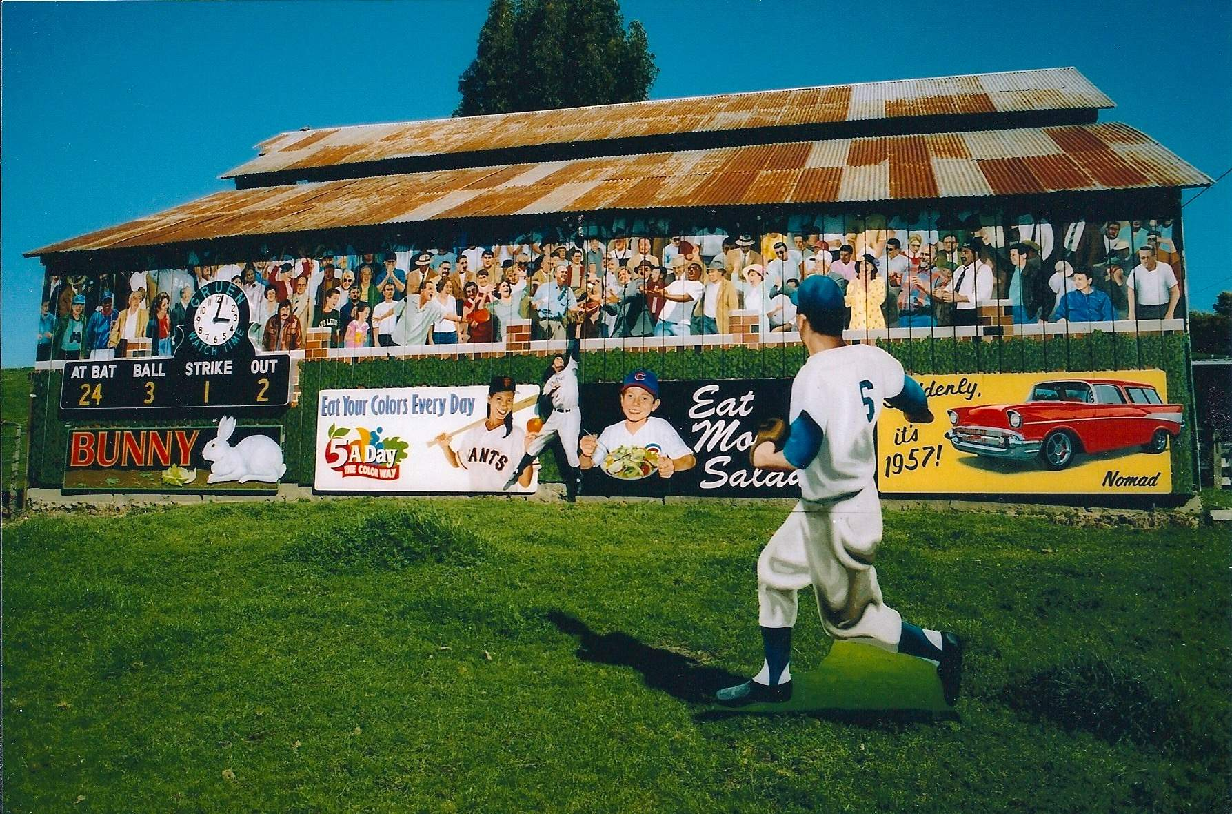 This barn on Highway 101 north of Salinas, Calif., changed its theme from 'Enjoy the Drive' to the baseball scene 'Enjoy the Game' in 1991, and in this image from 2005 when it was restored. It depicts the golden era of baseball from the 1940's and 50's.