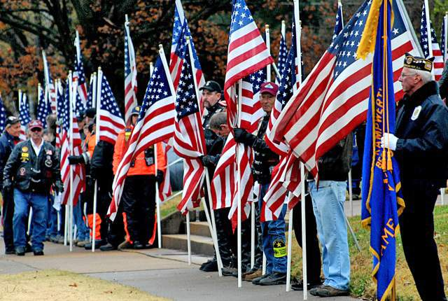 A flurry of American flags greets the funeral entourage for PFC Tyler Iubelt last November.