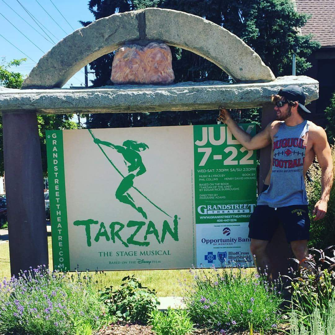Du Quoin's Hayden Schubert shows off a sign promoting this month's production of 'Tarzan' at the Montana-based Grandstreet Theatre.