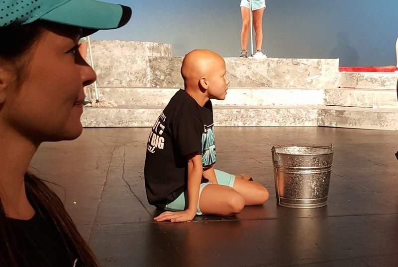 Tracey Webb looks on as her daughter, Josie, prepares to rehearse 'It's a Hard-Knock Life' from 'Annie,' one of the numbers to be performed at the Pyramid Players gala next weekend. The Webbs are just one of several sets of parents and children sharing the stage for the 40th anniversary event.