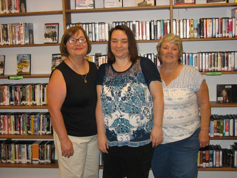 (Left to Right) Betty Eastman, Becky Hagerling and Pat Purnell, who submitted several of their sports-related photographs to be displayed at the Du Quoin Public Library, attended the reception for the photography exhibit Monday night.