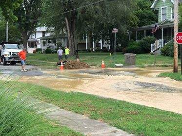 City employees work to repair a water line break near the 400 block of West Church Street in Benton Thursday afternoon. A boil water is in effect for parts of Benton until further notice.