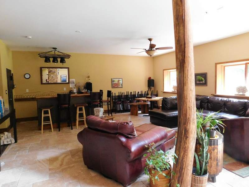 The lower level of the Inn features a dry bar, seating areas around a stone fireplace, books, and even a chess table at the ready.