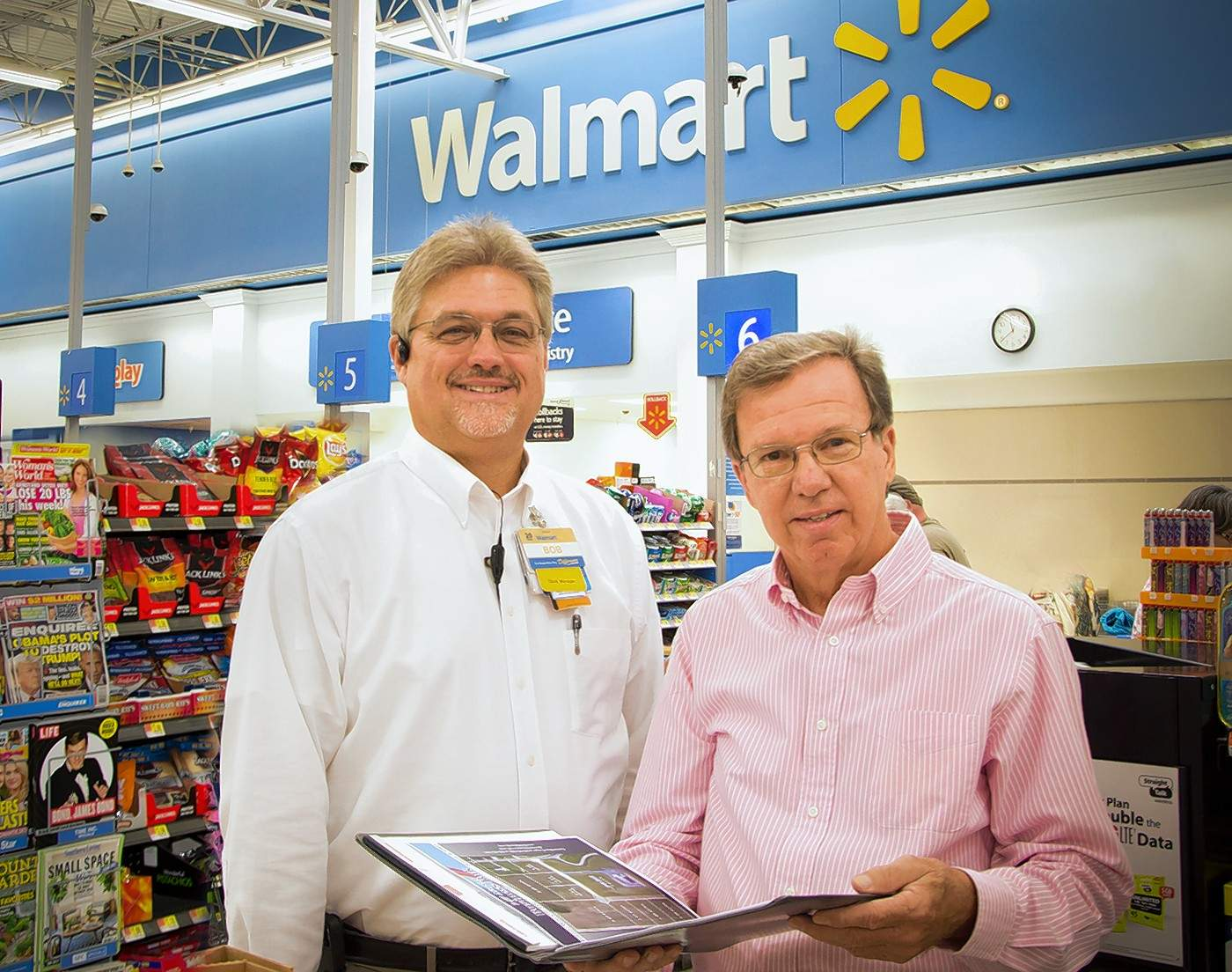 Dave Cooper, executive director of the BWCEDC, shows Walmart store manager Bob Brothers the latest development at the I/57 Airport Business Park.