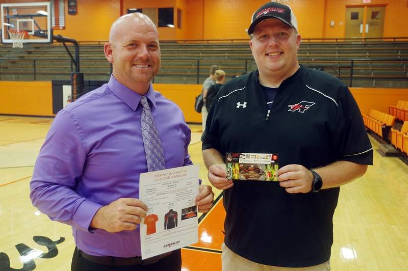 """Chester High School Athletic Director Jeremy Blechle (left) and Cody White, with Adrenaline Fundraising recently met with CHS fall and winter athletes to kick off the 2017-18 all-sports fundraiser. The athletes are selling the popular """"Gold Card"""" discount cards again this year to raise money to help support Yellow Jacket sports."""
