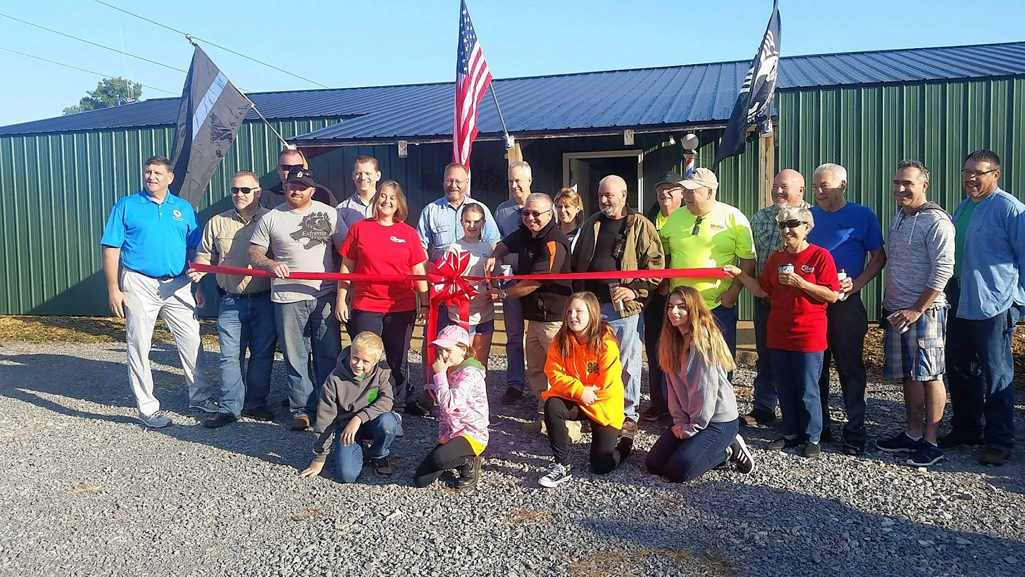 City officials and Chamber members gathered Friday for a ribbon-cutting ceremony to welcome Extreme Exigency to Benton.