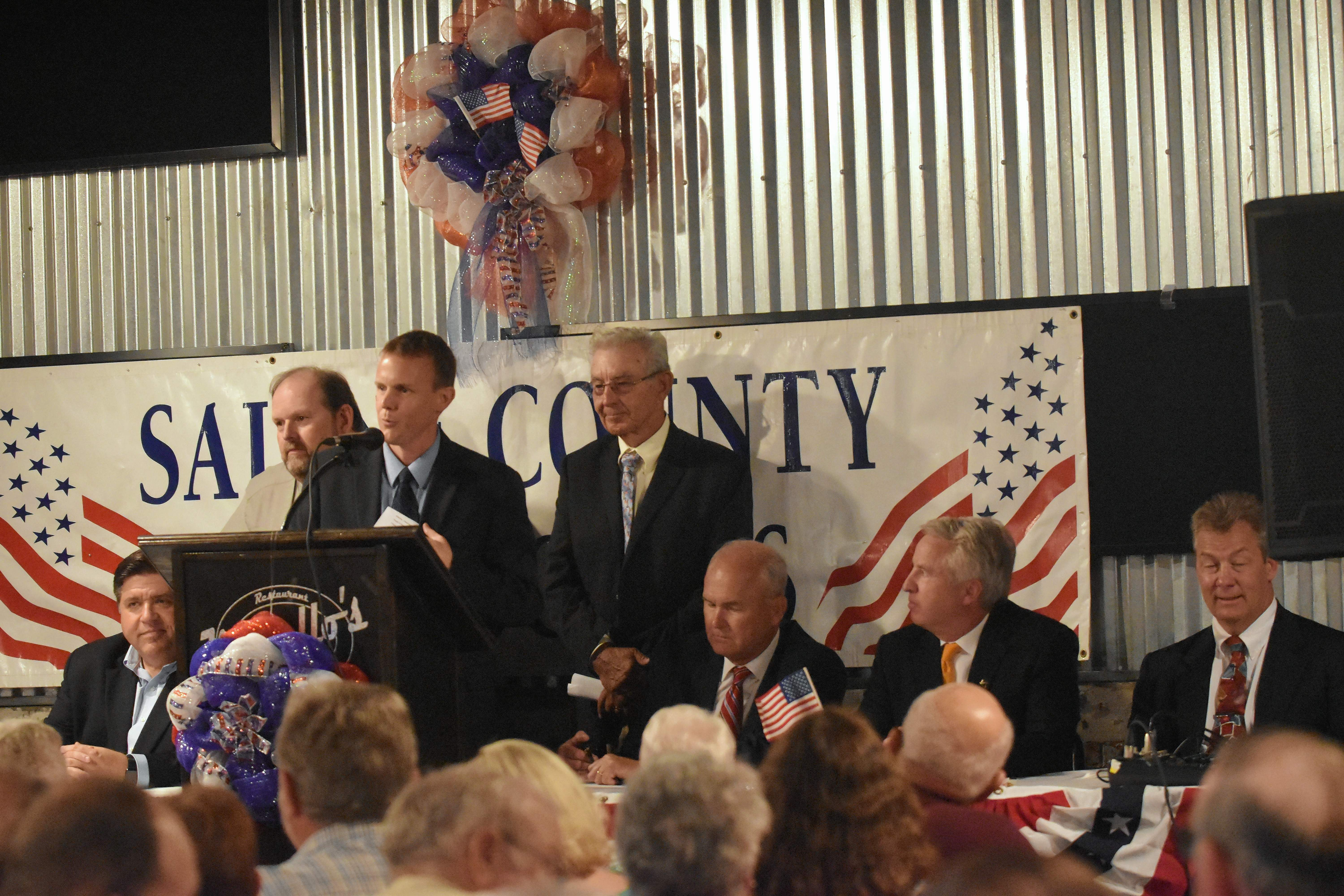 Saline County State's Attorney Jayson Clark speaks at the county Democrats' forum for gubernatorial candidates Saturday night at Morello's Restaurant in Harrisburg. From left are J.B. Pritzker, Saline County Democrat Bruce Tolley, Clark, Saline County Democrat Central Committee President Bob Oglesby, Bob Daiber, Chris Kennedy and congressional candidate Carl Spoerer.