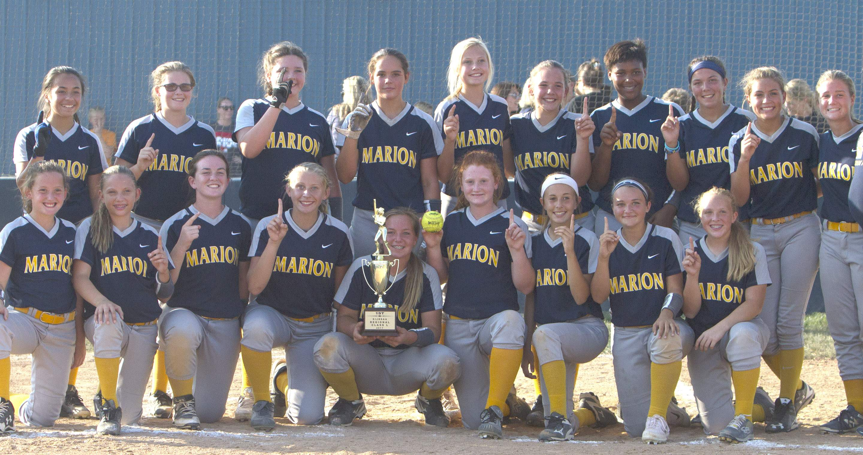 The MJHS softball team poses with the regional championship trophy.