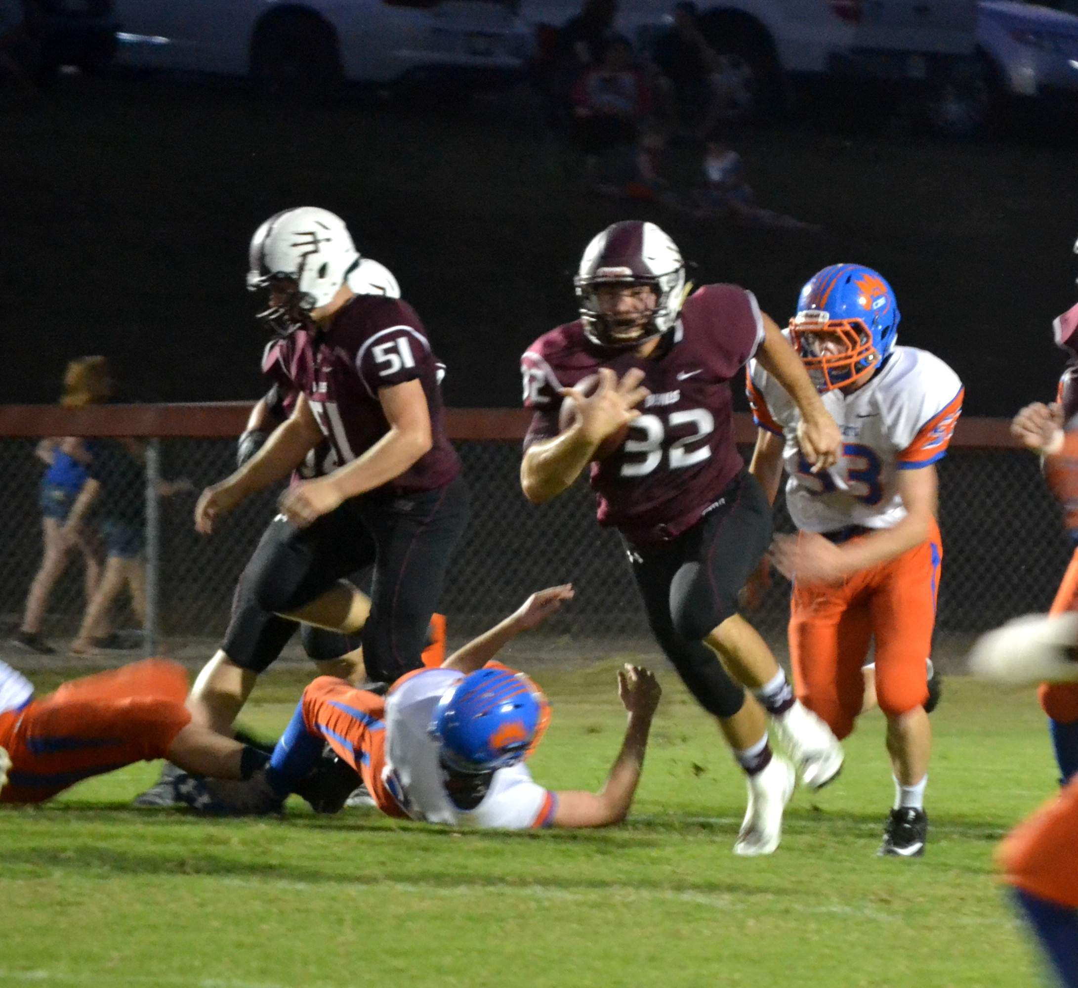 S-V-W-W's Peyton Rock finds a hole during Friday's action at Carroll Kelly Field. Rock racked up 152 yards rushing and scored twice as the Red Devils blanked the Bearcats 66-0.