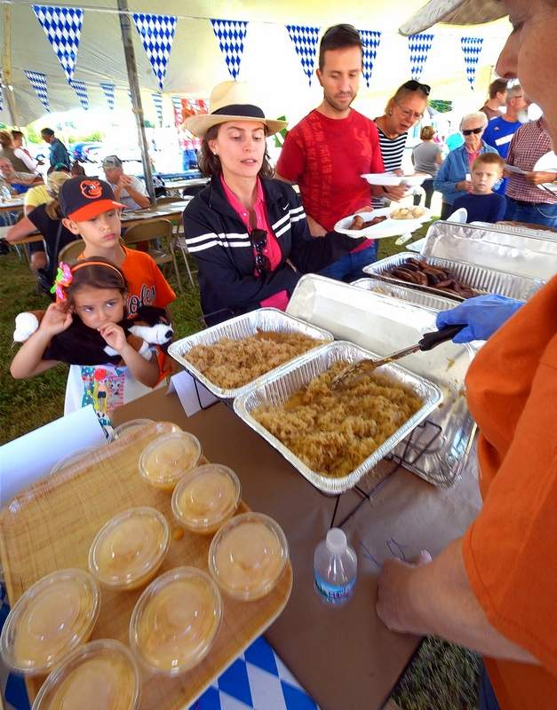 Juan Gonzalez and his family made their way down the food line at this past weekend's Oktoberfest at Zion United Church of Christ in Marion.