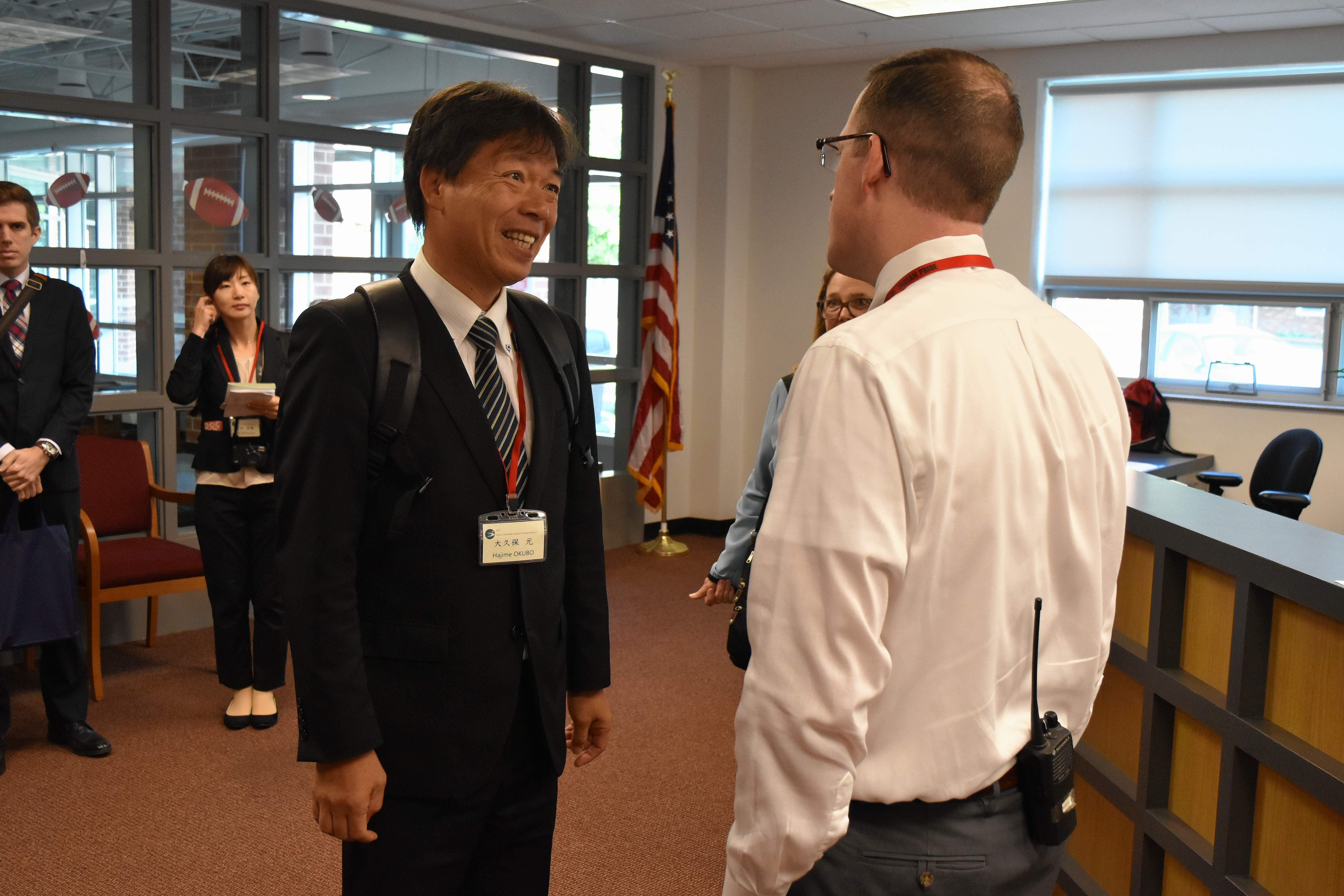 Hajime Okubo, principal of Kinoto Junior High School in Tainai, Japan, greets Du Quoin High School Principal Matthew Hickam during a visit to the school Monday morning.