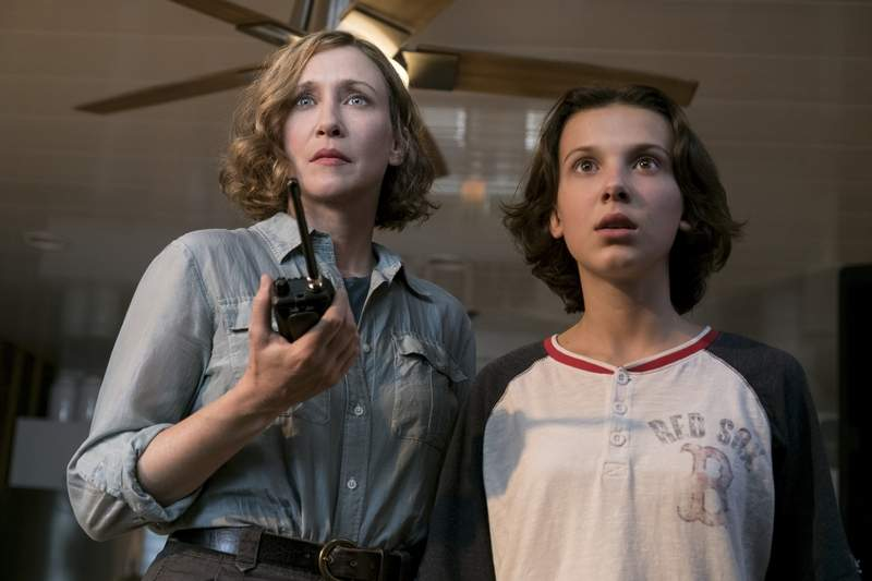 Dr. Emma Russell (Vera Farmiga), left, and her daughter Madison (Millie Bobby Brown) face a threat from eco-terrorists in 'Godzilla: King of the Monsters.'