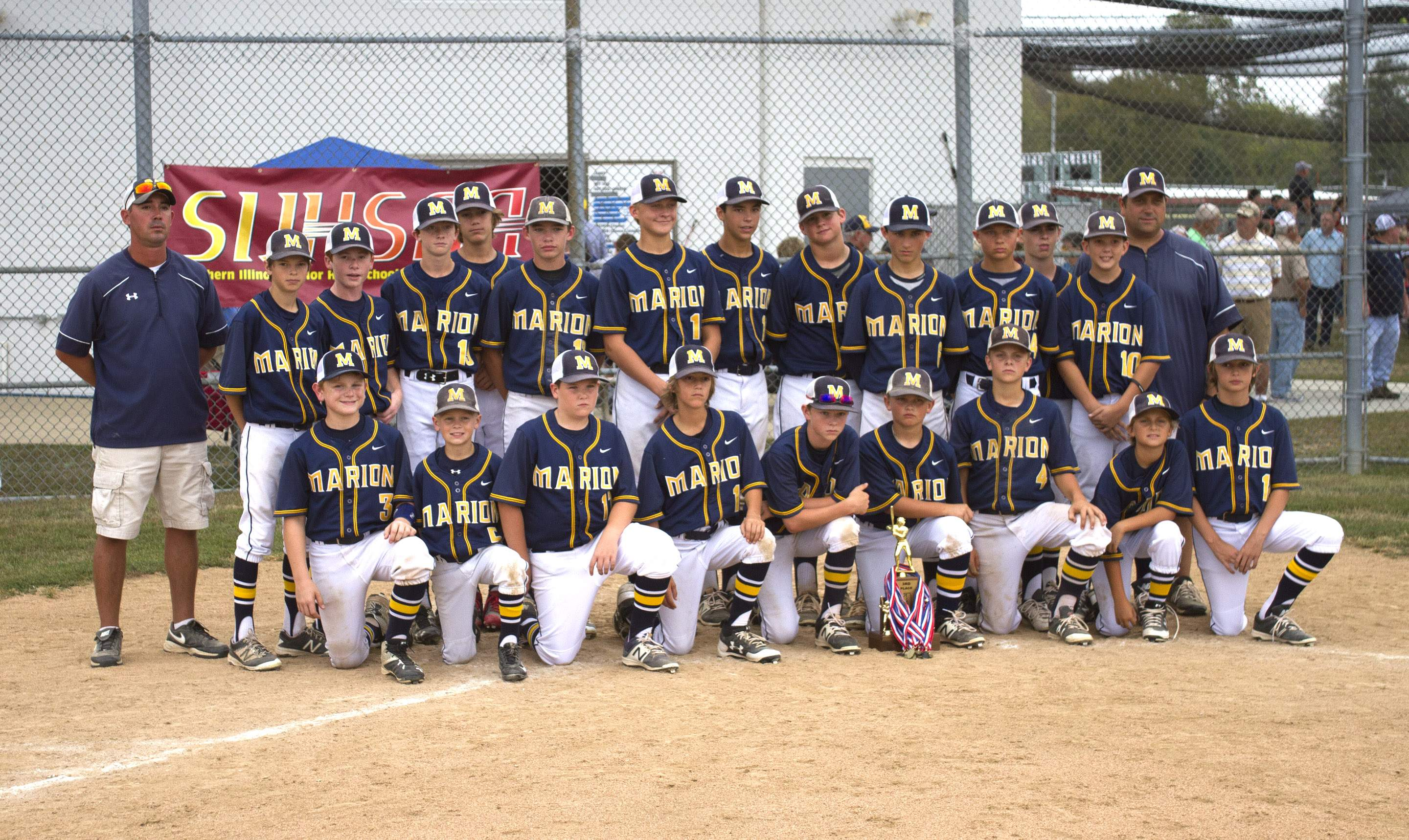 The MJHS baseball team poses with the third place trophy.