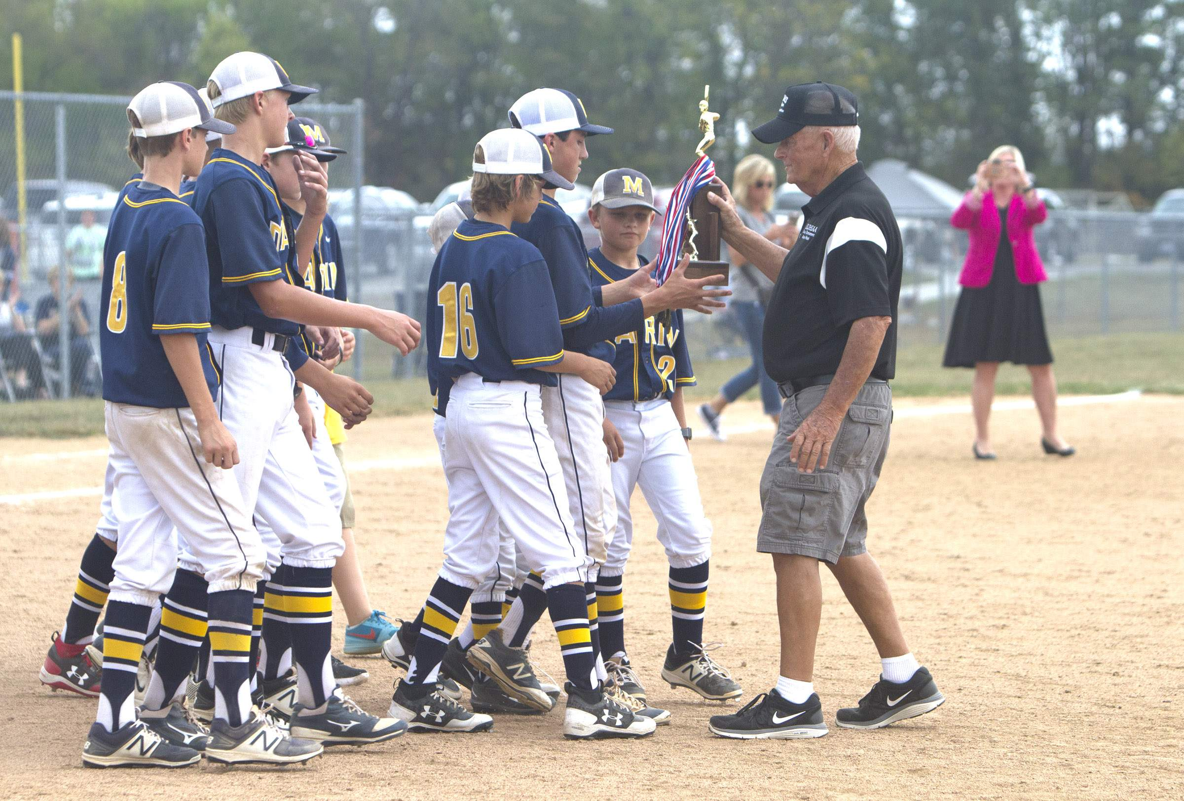 Marion's players receive the trophy.