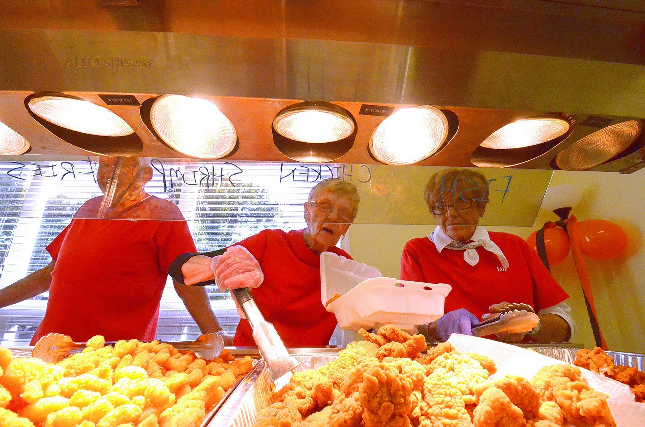 St. Joseph Church members Mike Svenski, Patsy Nave and Lou Cooper kept busy filling take-out orders Friday. For the complete story, see page 2.