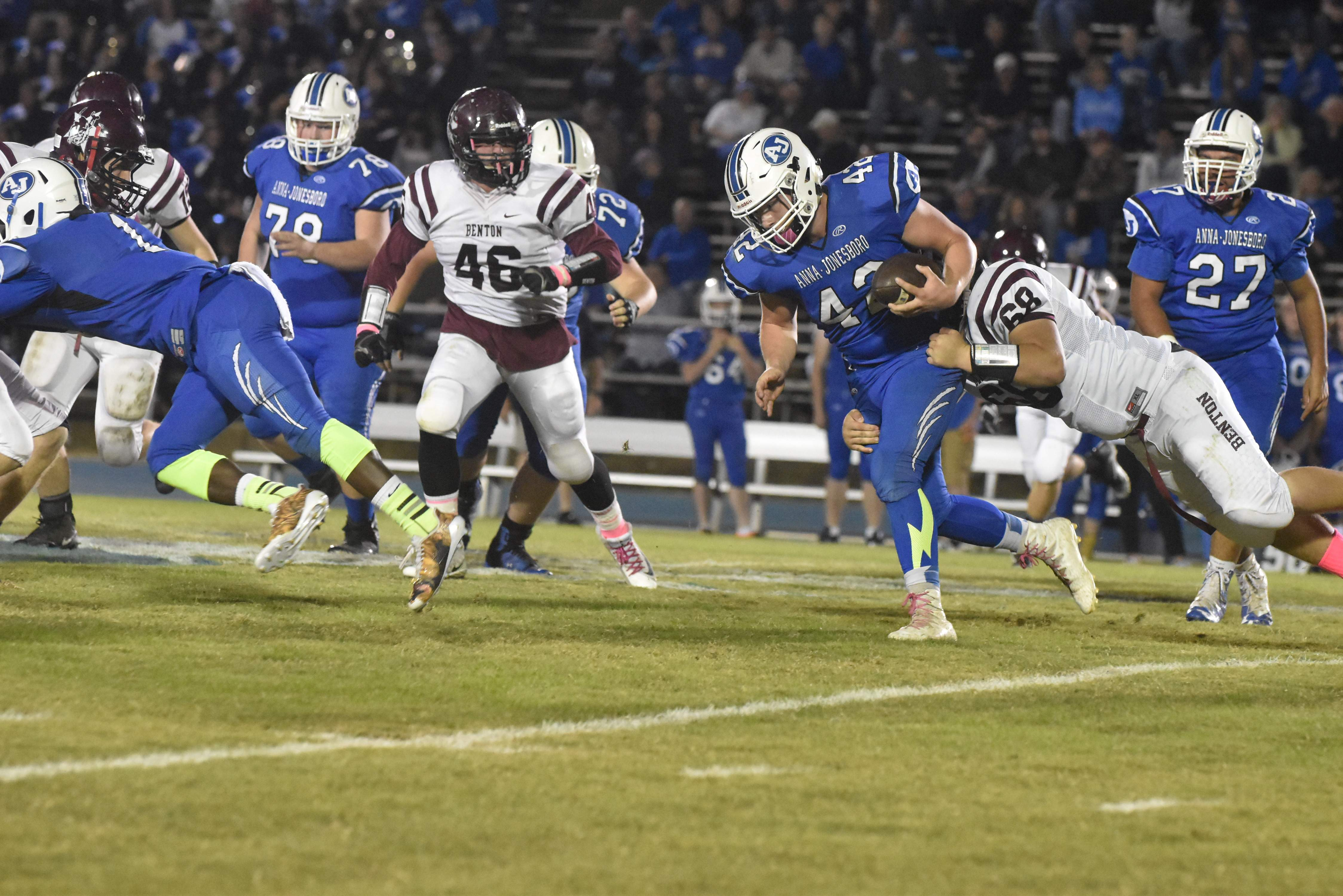 Benton's Warren Smothers chases Anna-Jonesboro running back Jayce Turner during first half action in Anna on Friday night. The Wildcats finished a perfect 9-0 season with a 66-28 victory over the Rangers.