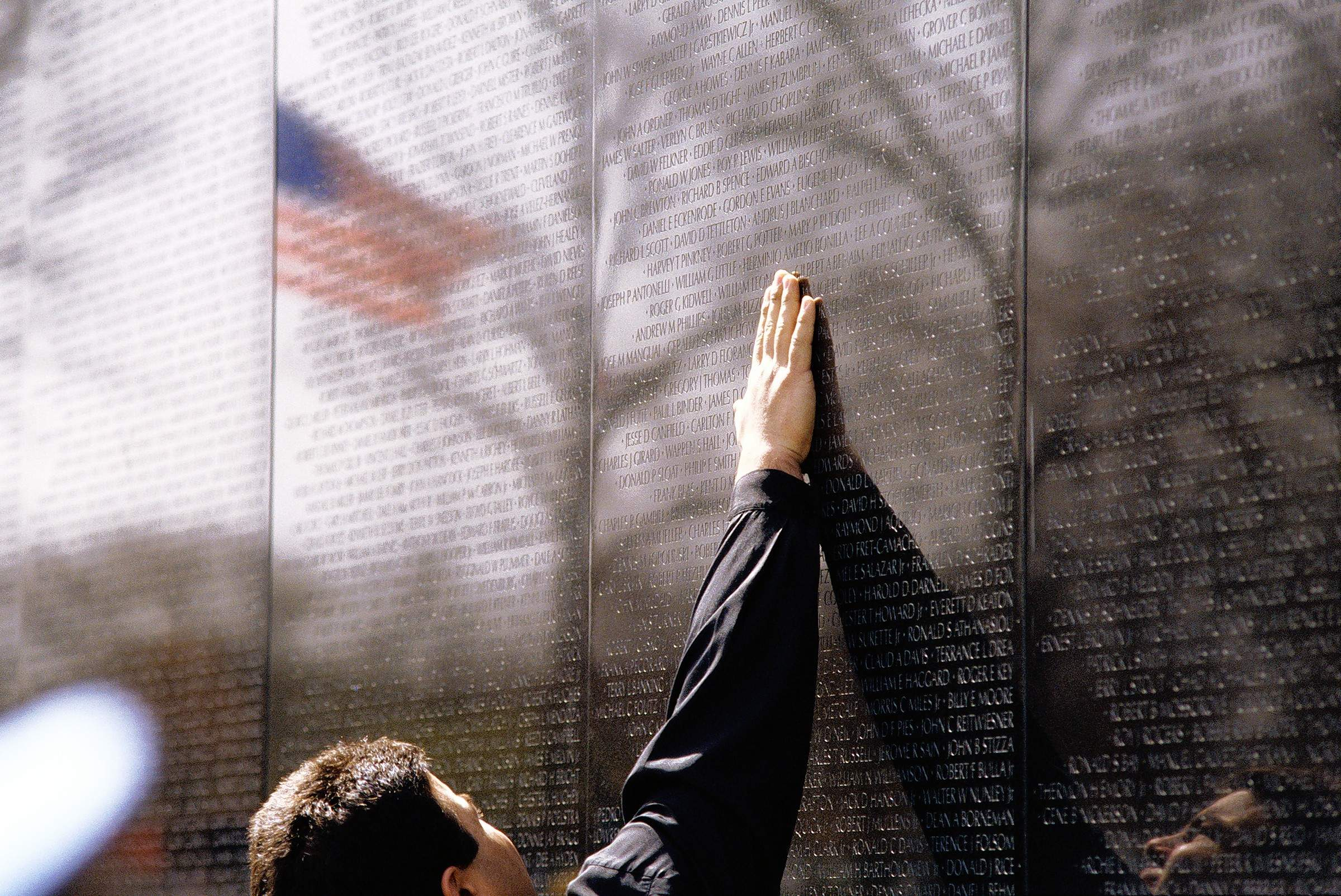 A visitor reads names on the Vietnam Veterans Memorial in Washington, D.C.