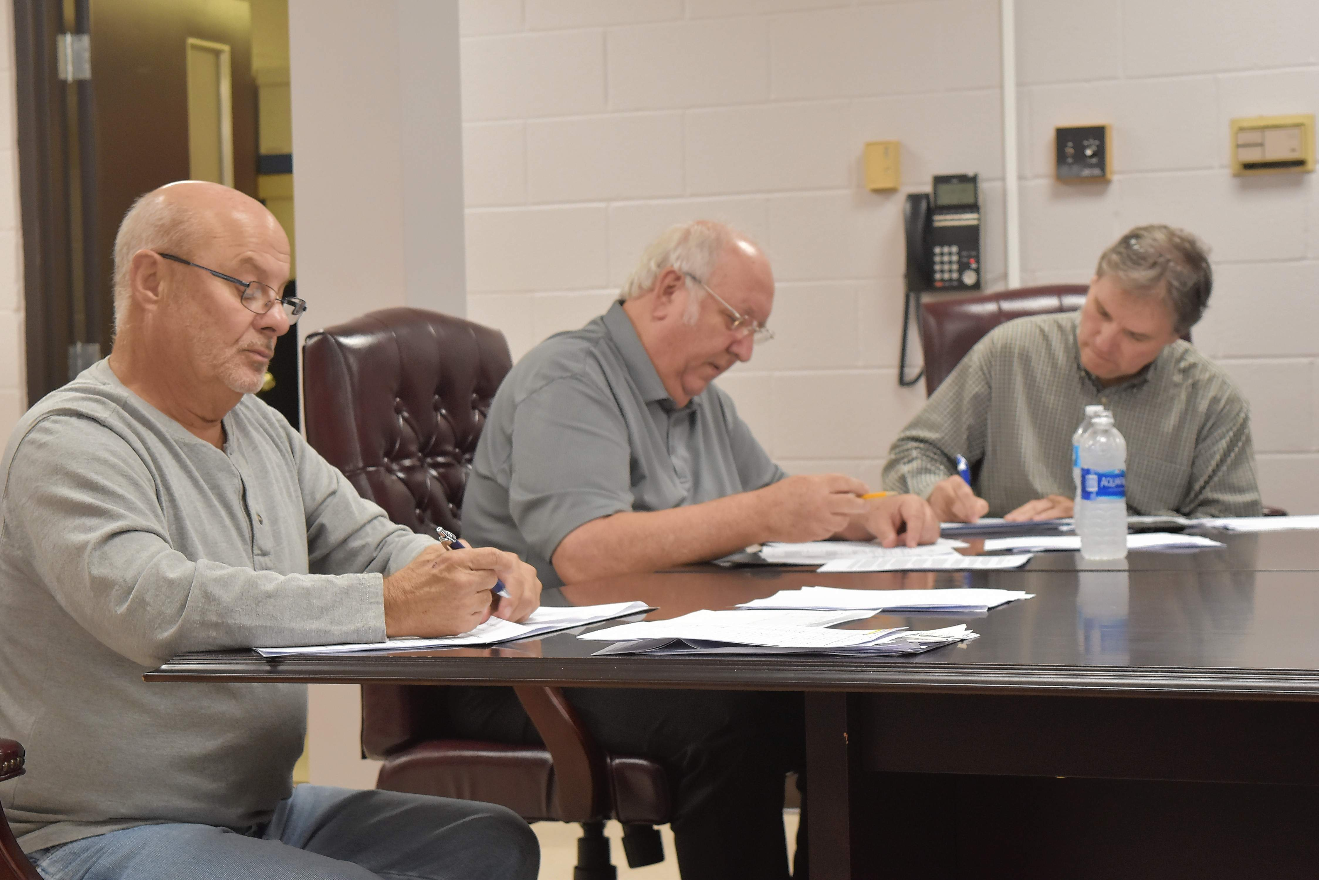 Benton Finance Commissioner Dennis Miller, second from left, said the city's annual financial report is now on public display and is expected to be approved in 30 days. At left is Commissioner Donald Storey, and at right is attorney Tom Malkovich.