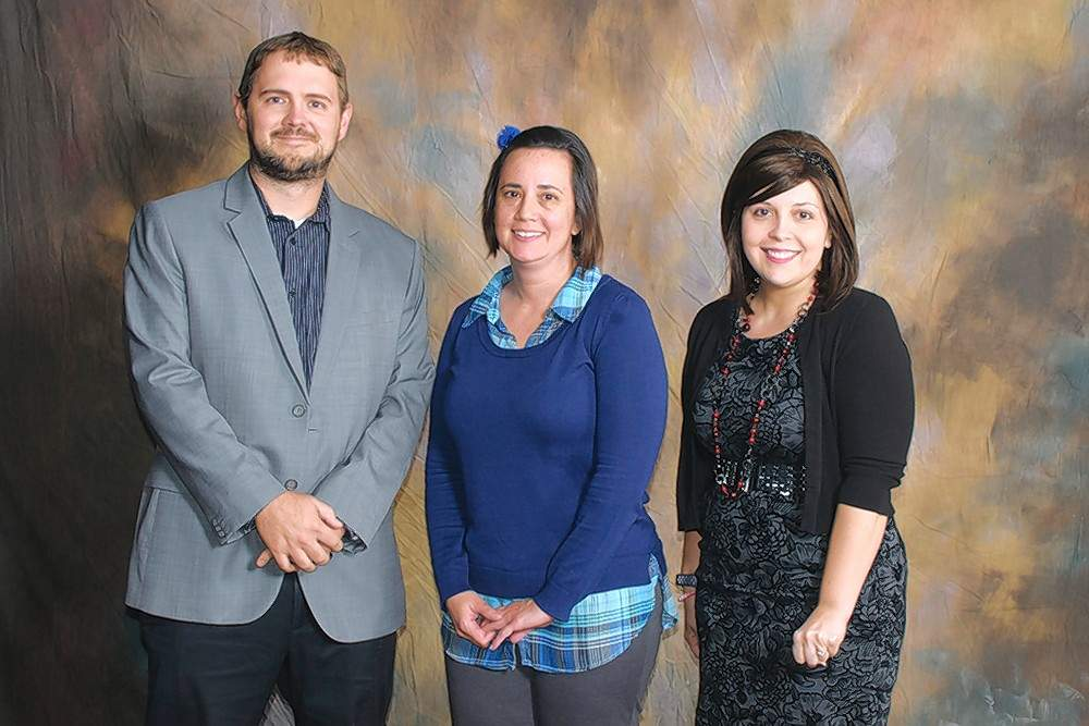 Brenda Scarber Memorial Scholarship recipient Angela Watkins (Tamaroa), center, is pictured with scholarship donors Eric Black and Linda Black.