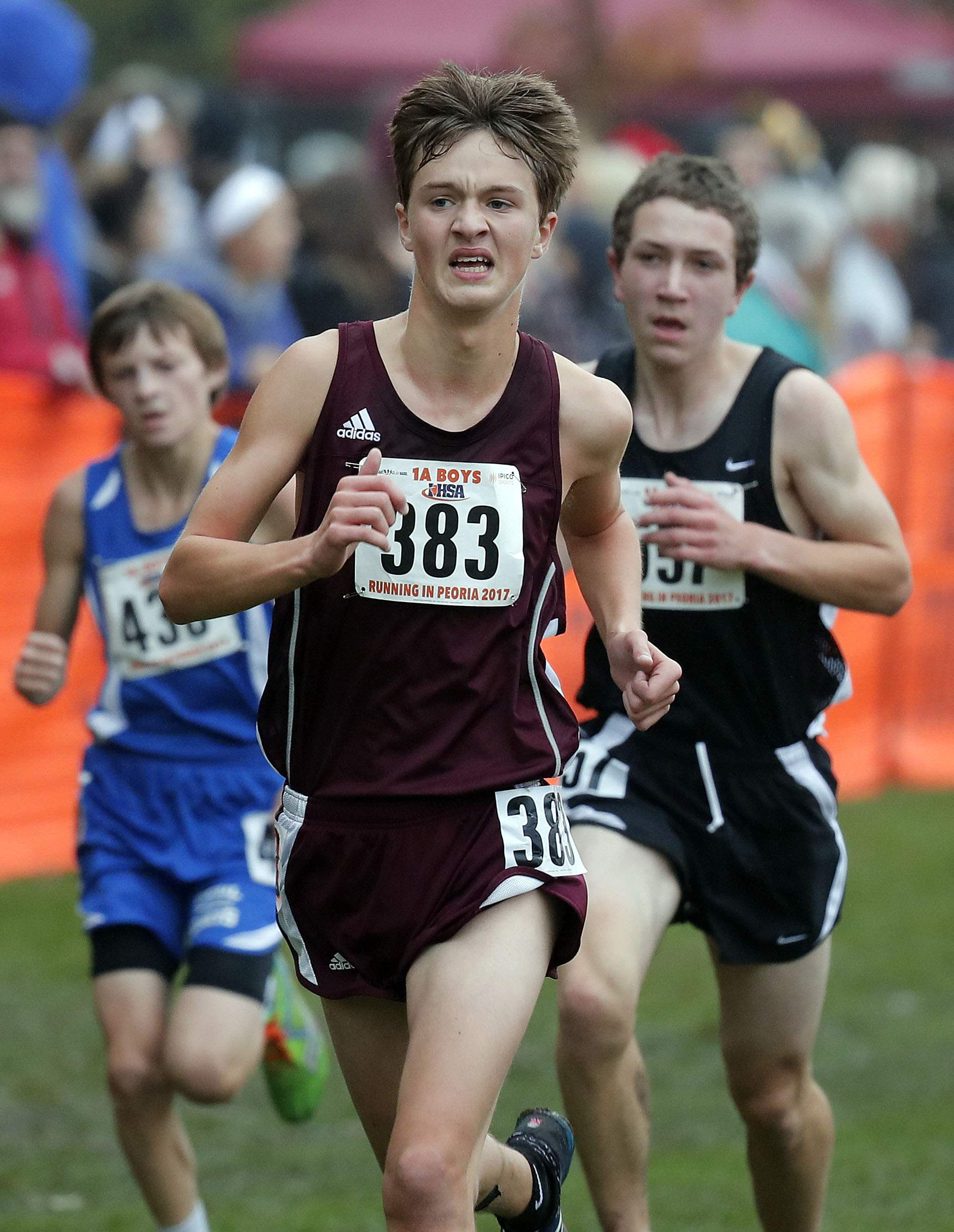 Benton's Brady Gischer heads to the finish line during the boys Class 1A cross-country finals Saturday in Peoria.