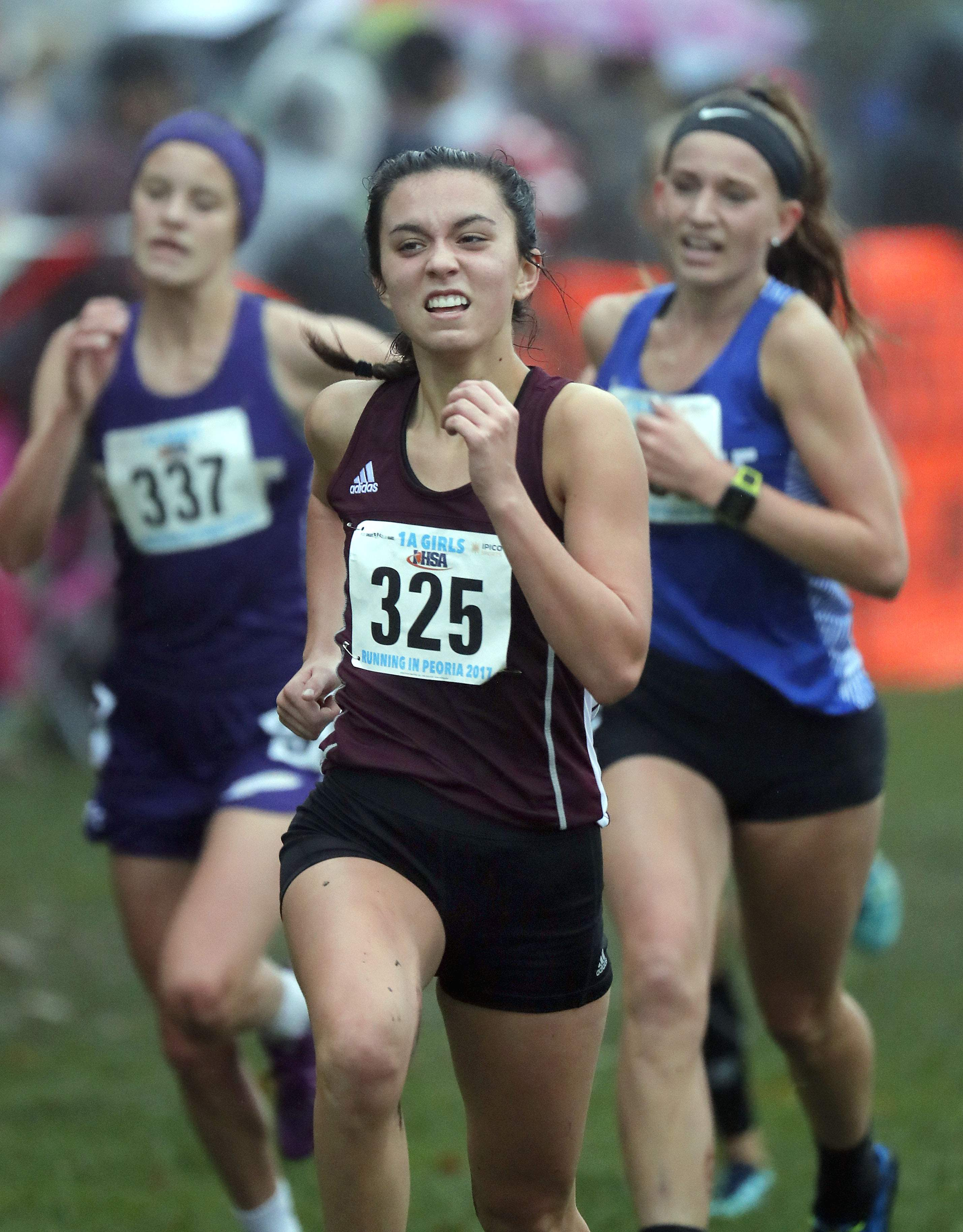 Benton's Amelia McLain heads to the finish line - and 9th place - during girls Class 1A cross-country finals Saturday in Peoria.