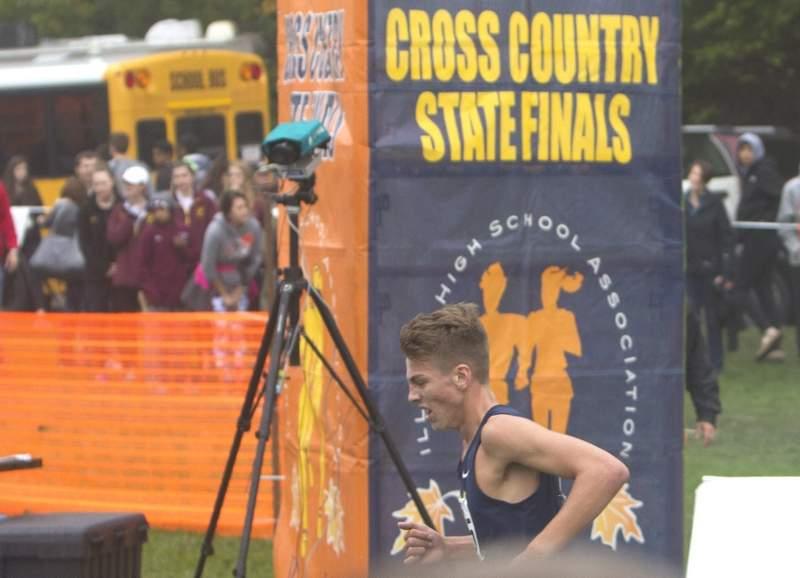 John Bruce crosses the finish line.