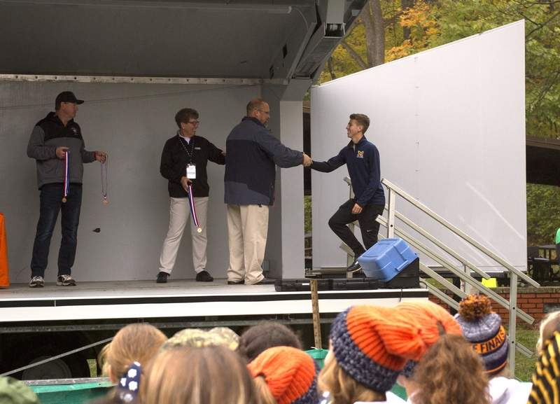 John Bruce receives his all-state medal.