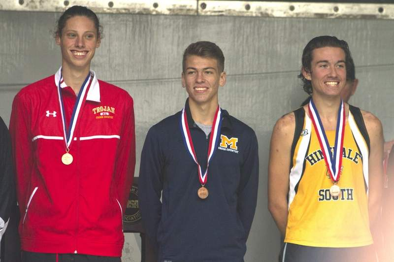 John Bruce wears his all-state medal.