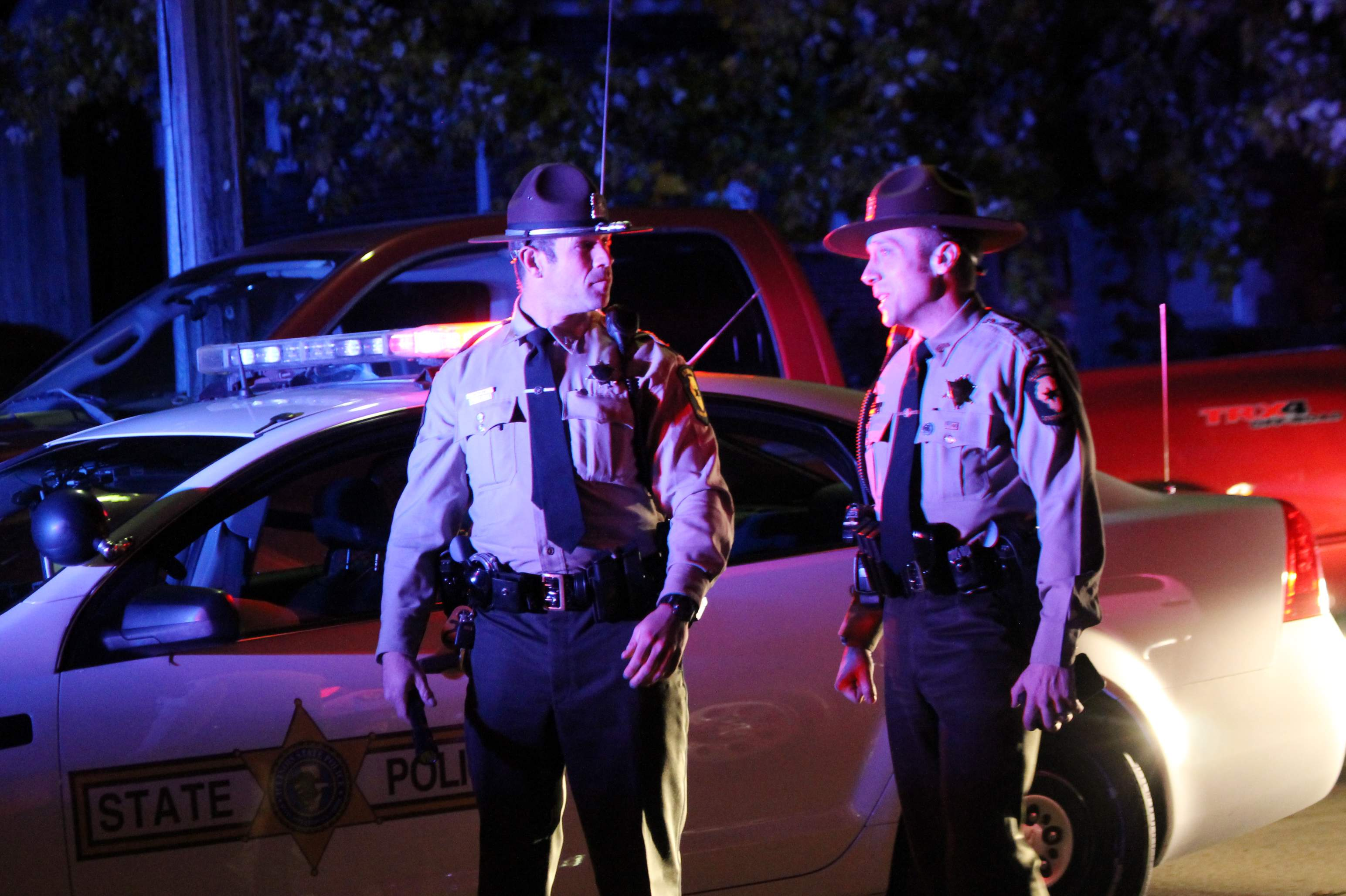 Two Illinois State Police troopers converse during the standoff.