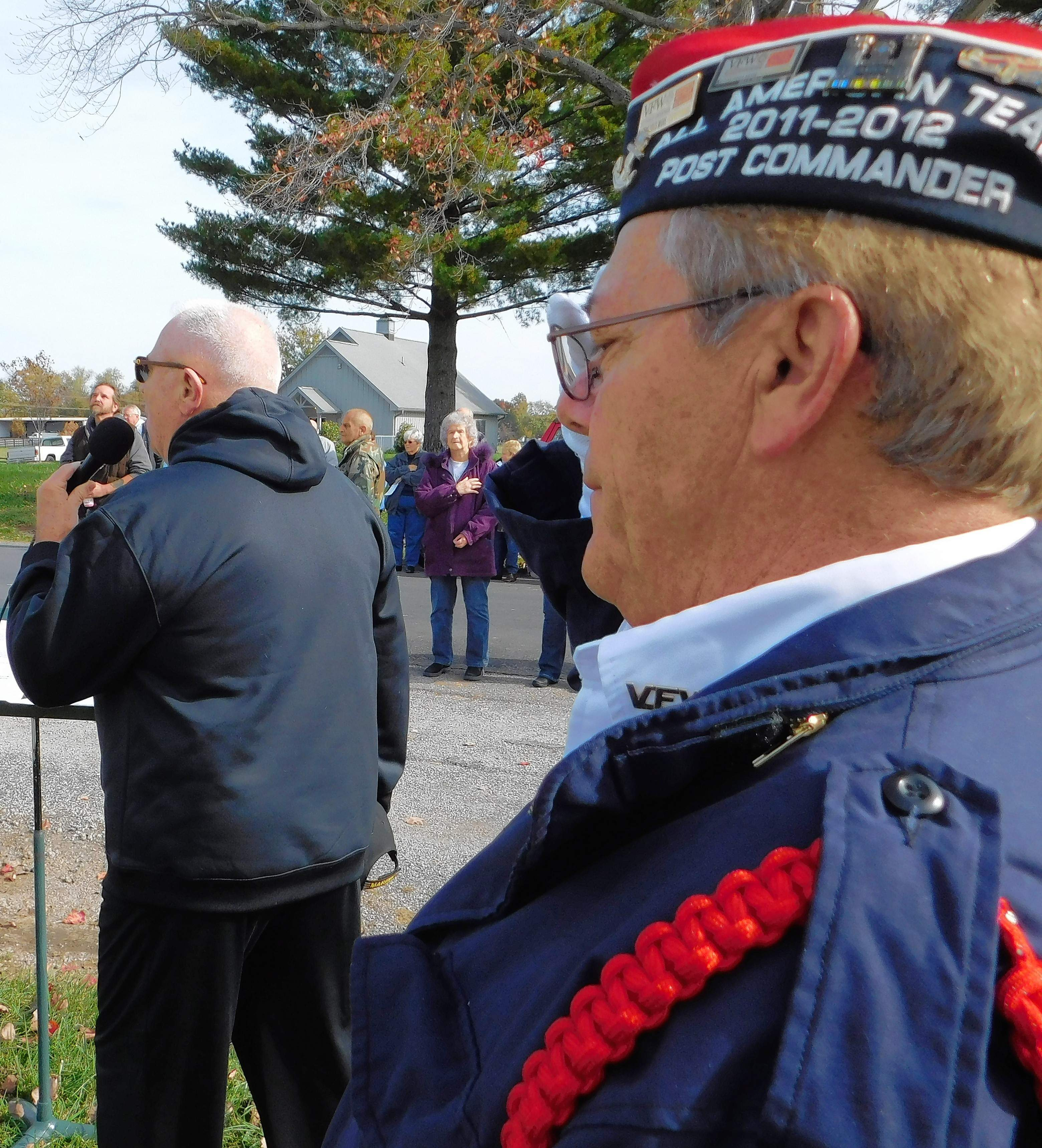 VFW Quartermaster John Metzger listens as Ron Head gives an impromptu rendition of 'The Star Spangled Banner.'