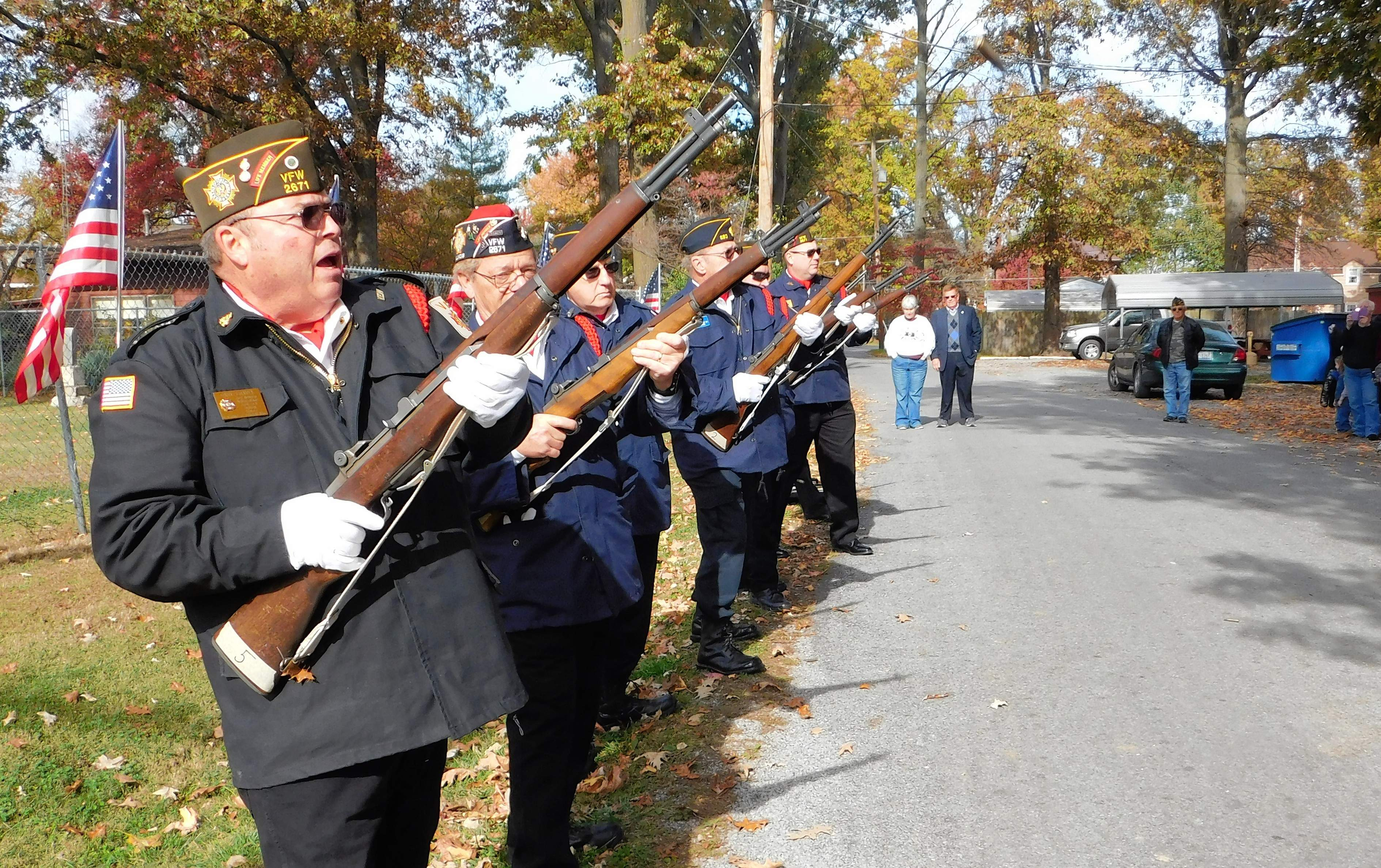 Members of the Honor Guard perform the traditional 21-gun salute outside the entrance to Benton's Civil War Cemetery. For the full story, see page 3.